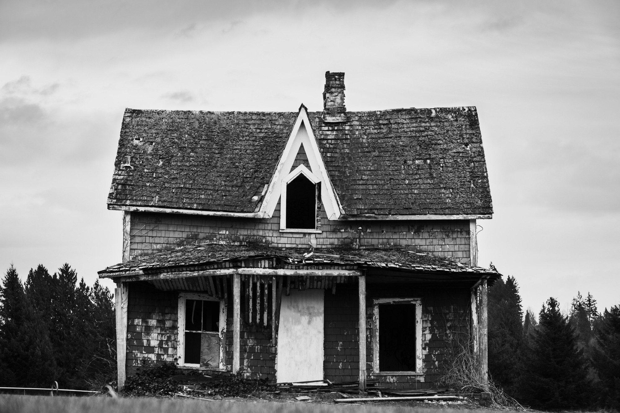 Black and white house in need of repair