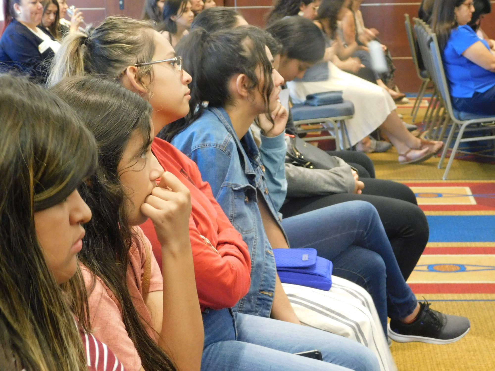 Latina students learning about the Digital Divide