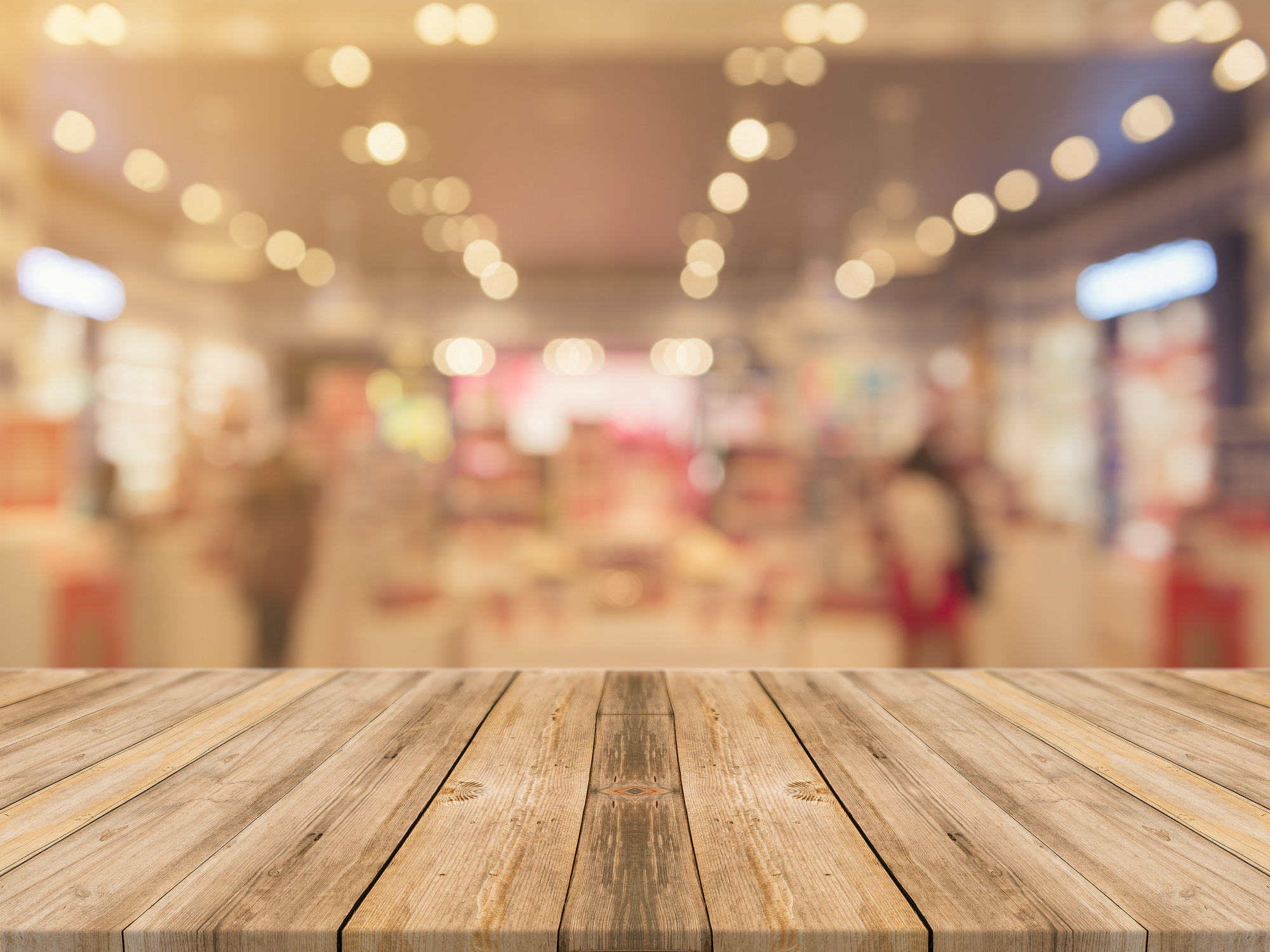 image of a wooden table in focus and a blurry background