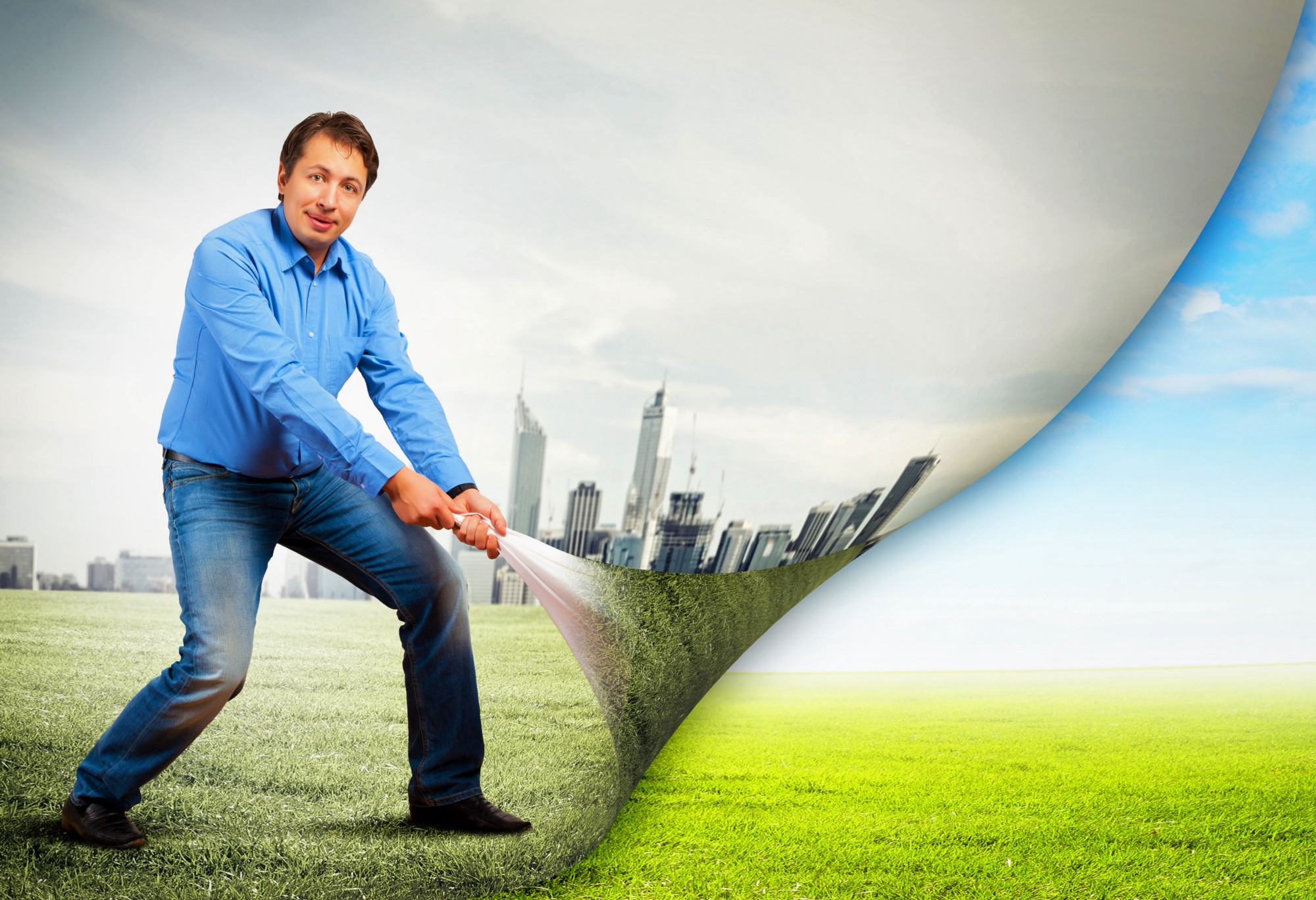 man wearing light blue shirt and blue jeans pulling corner of photo between old and new life