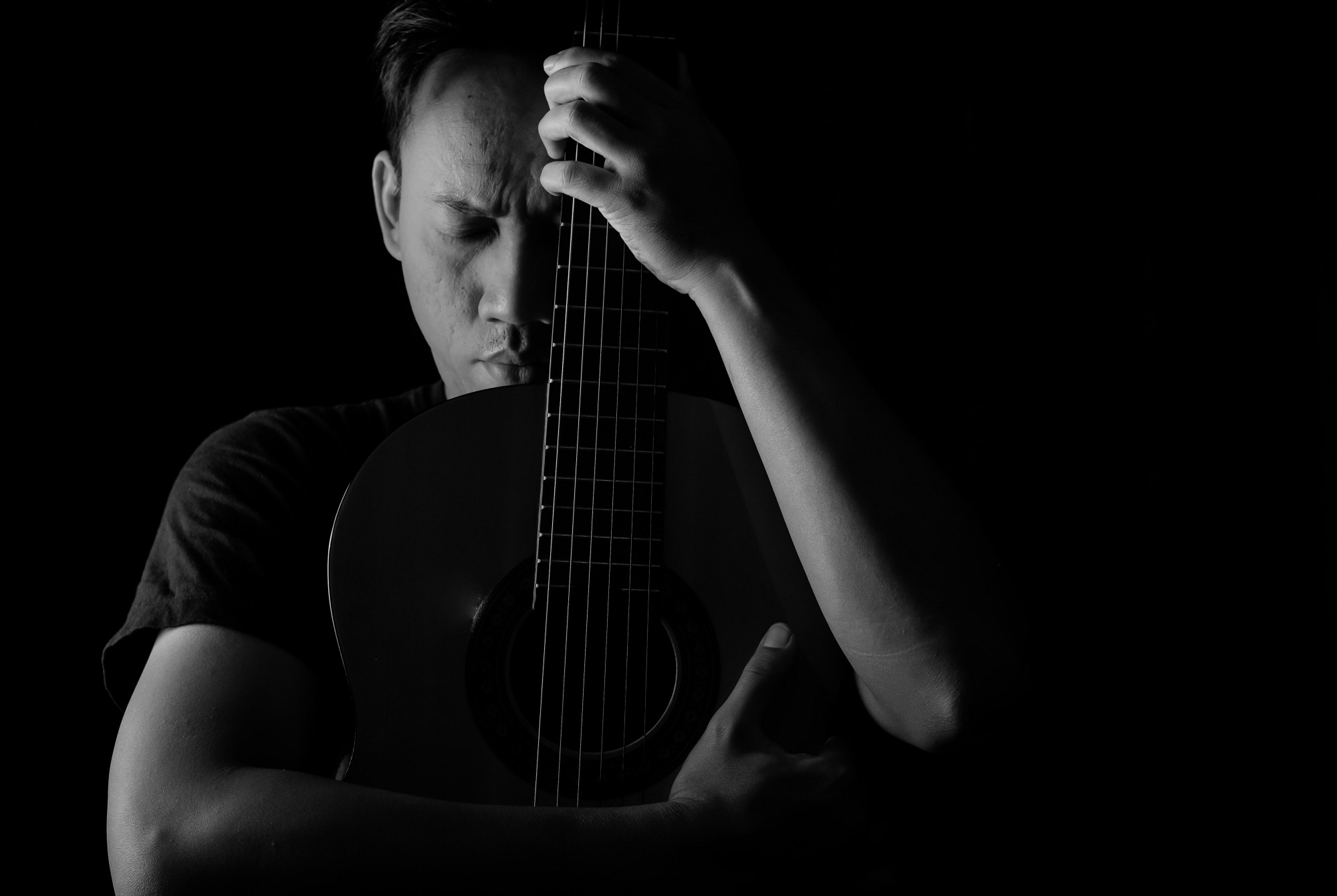 Reasons Why Self-Improvement Isnt Working in Your Life — portrait of a man with a guitar in black and white