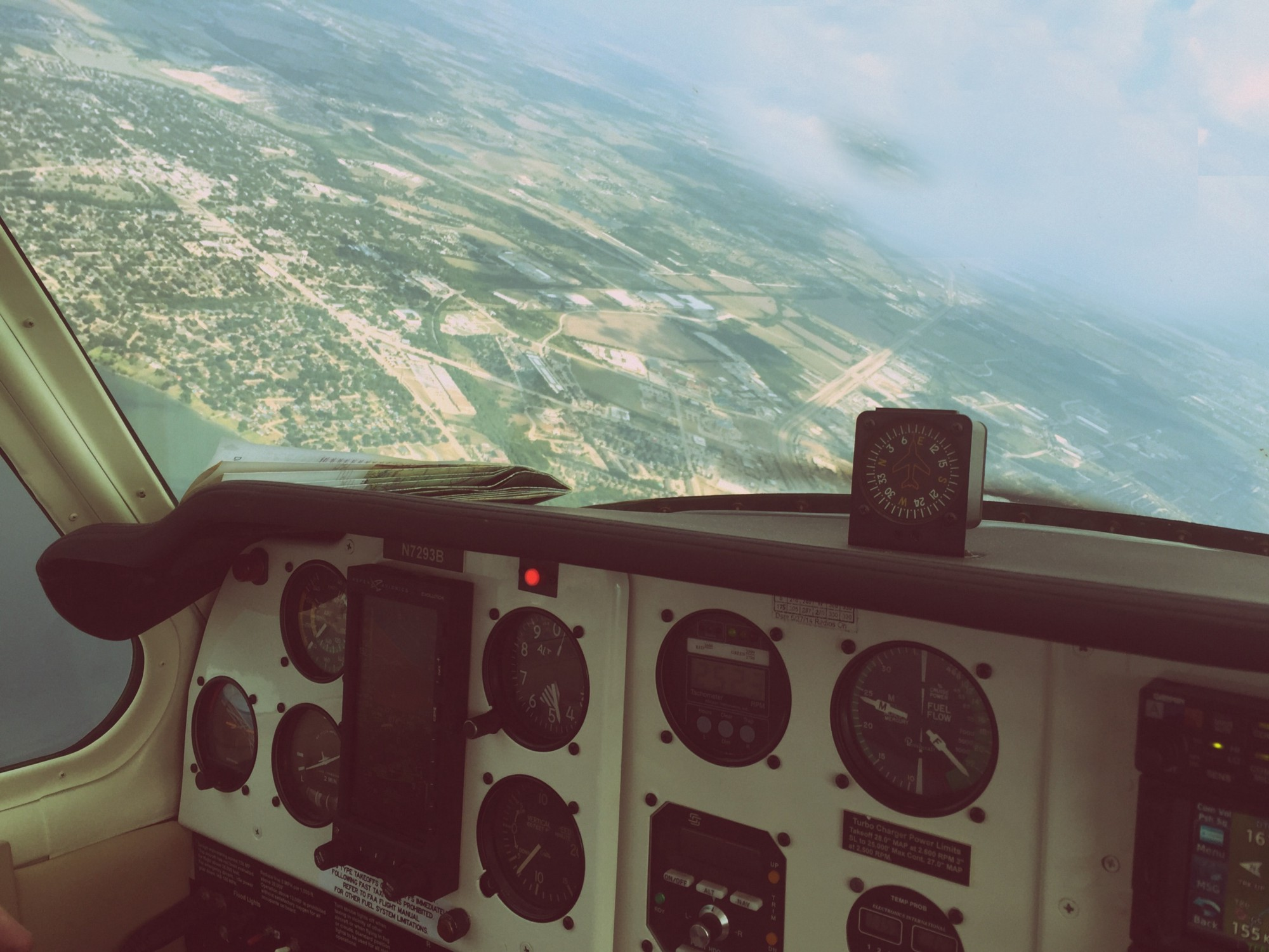 A view from the cockpit of a plane flying over the countryside
