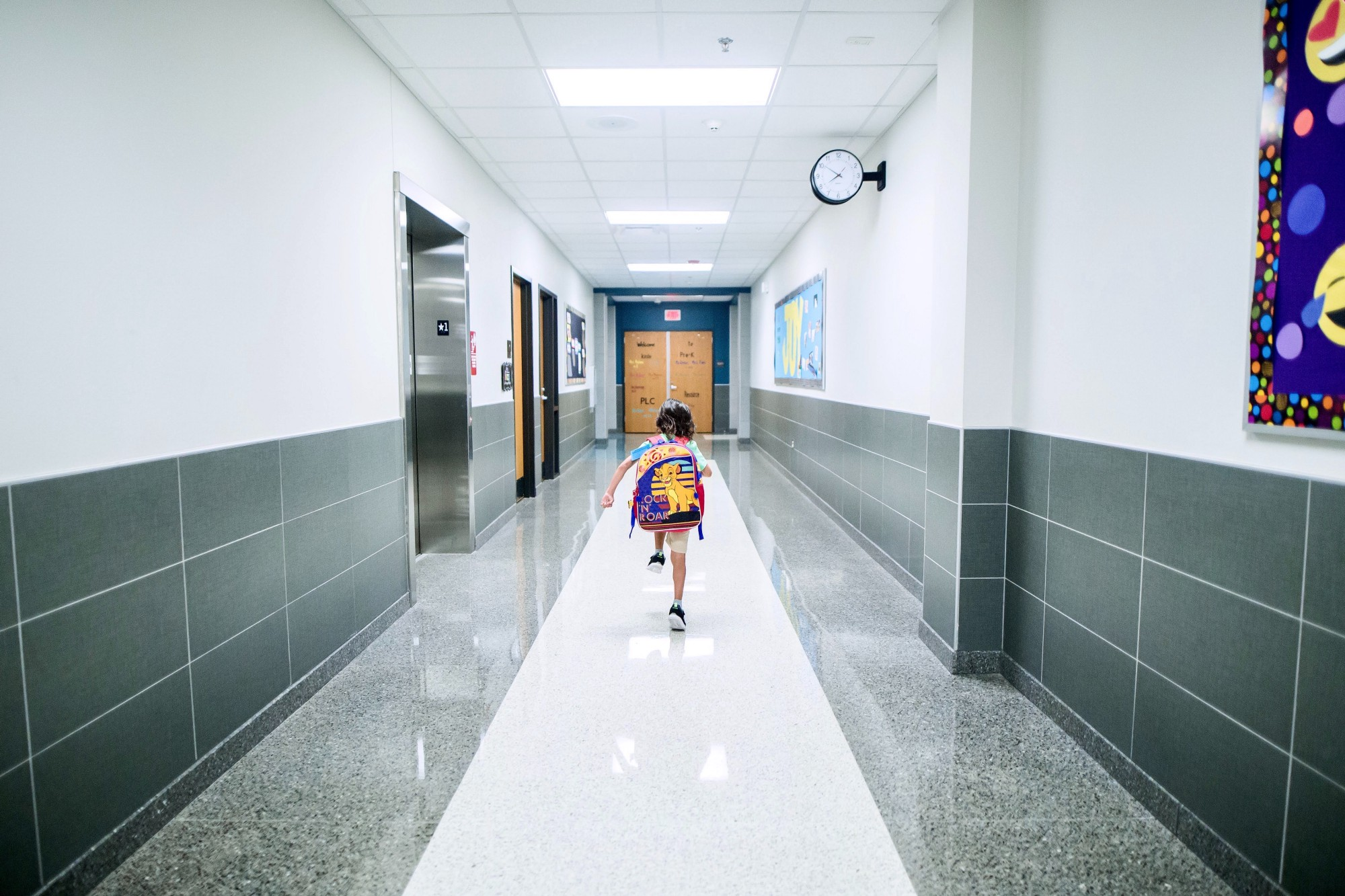 Boy running in the hallway at school.
