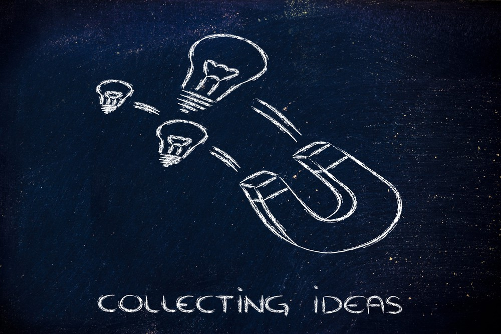 """Image of a magnet attracting lightbulbs with a caption, """"Collecting Ideas"""""""