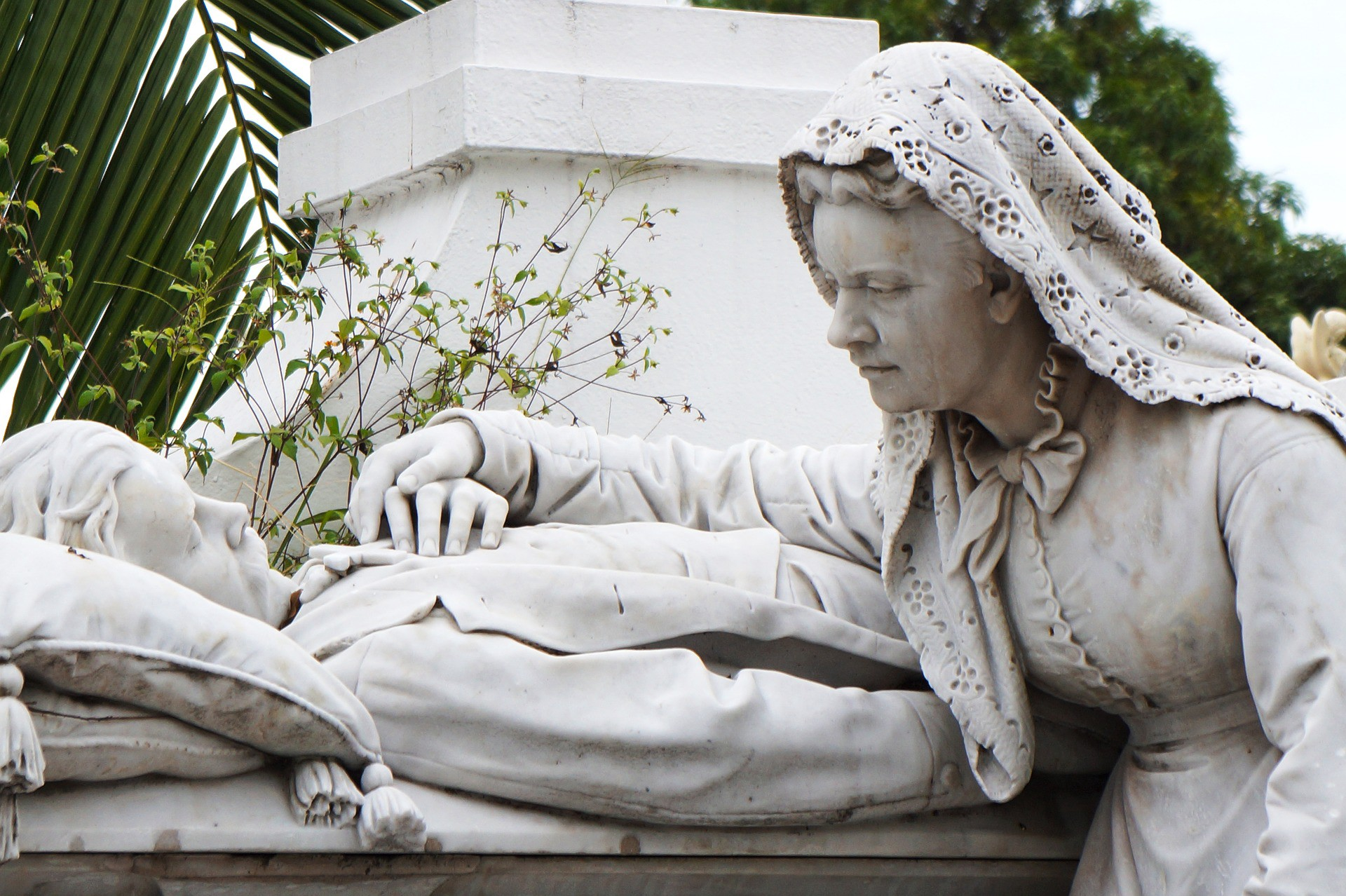 A statue of a grieving wife on the bedside of her dying husband. Death and Grief.