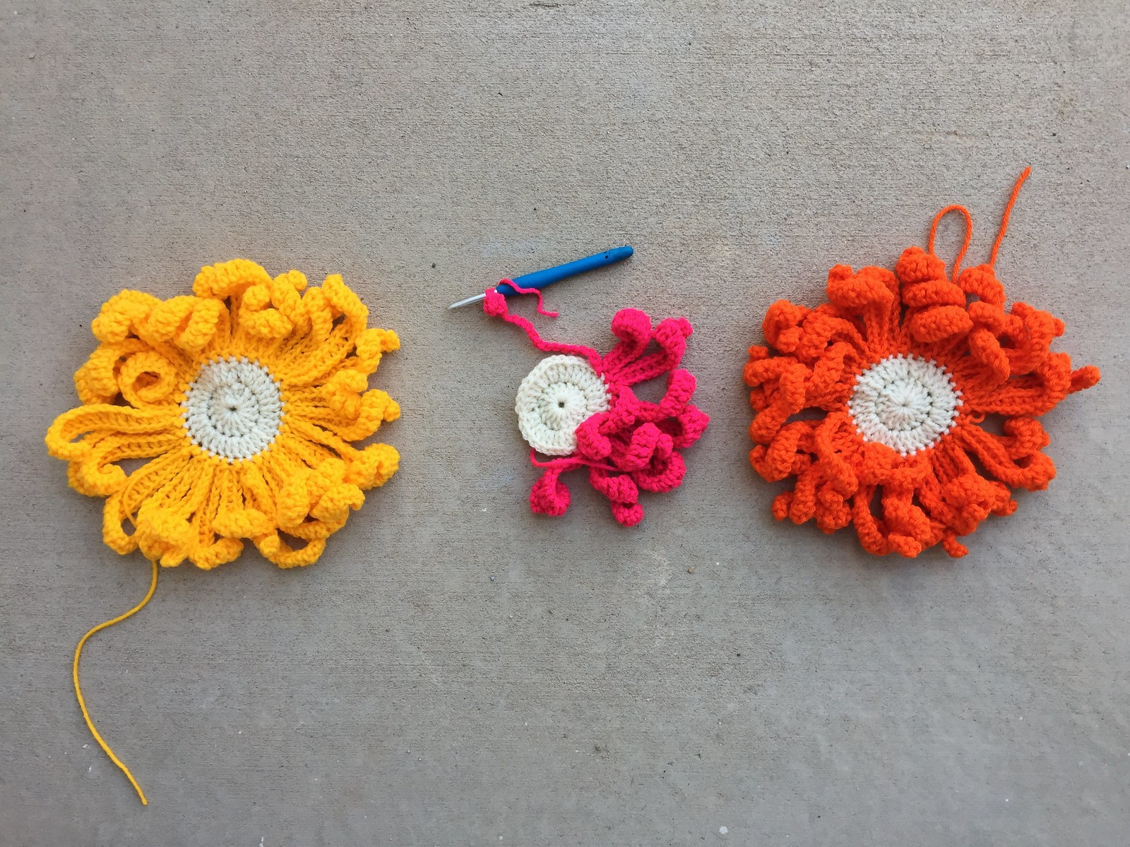 Two-and-a-half great big, bright, crochet flowers