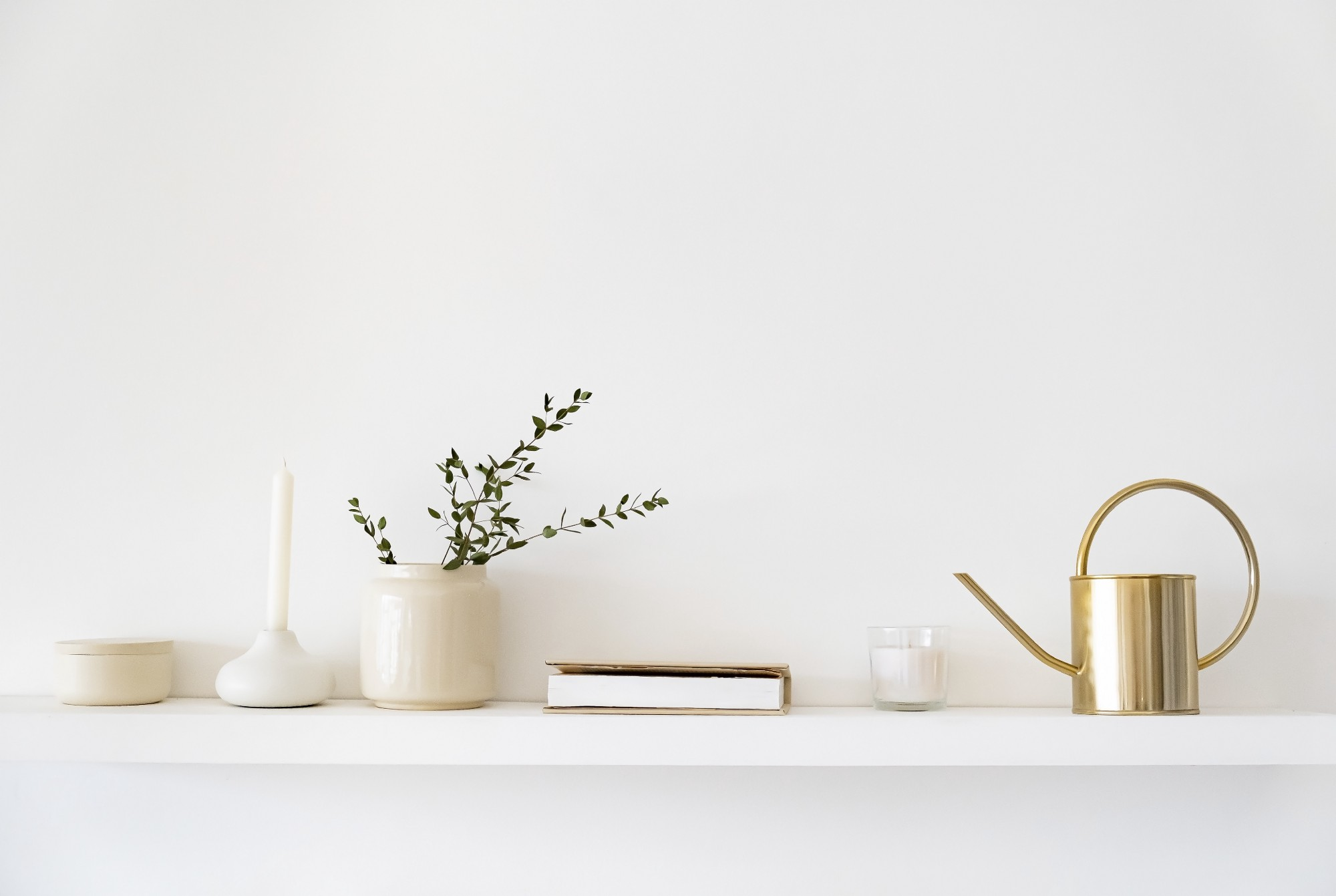 Minimalistic scandinavian interior. dishes on white shelves. white details in the interior