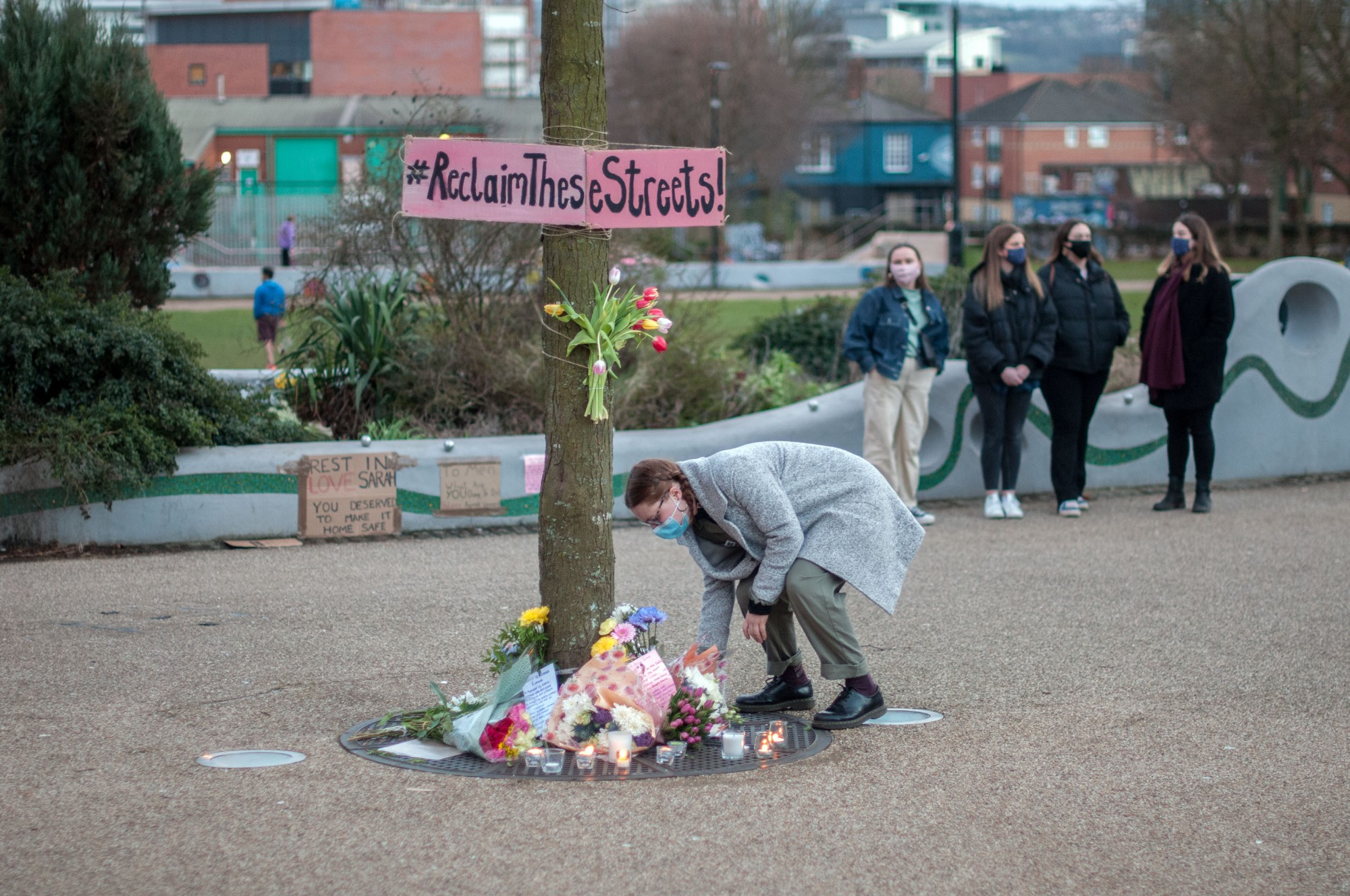 Flowers being laid at a vigil for Sarah Everard in Sheffield.