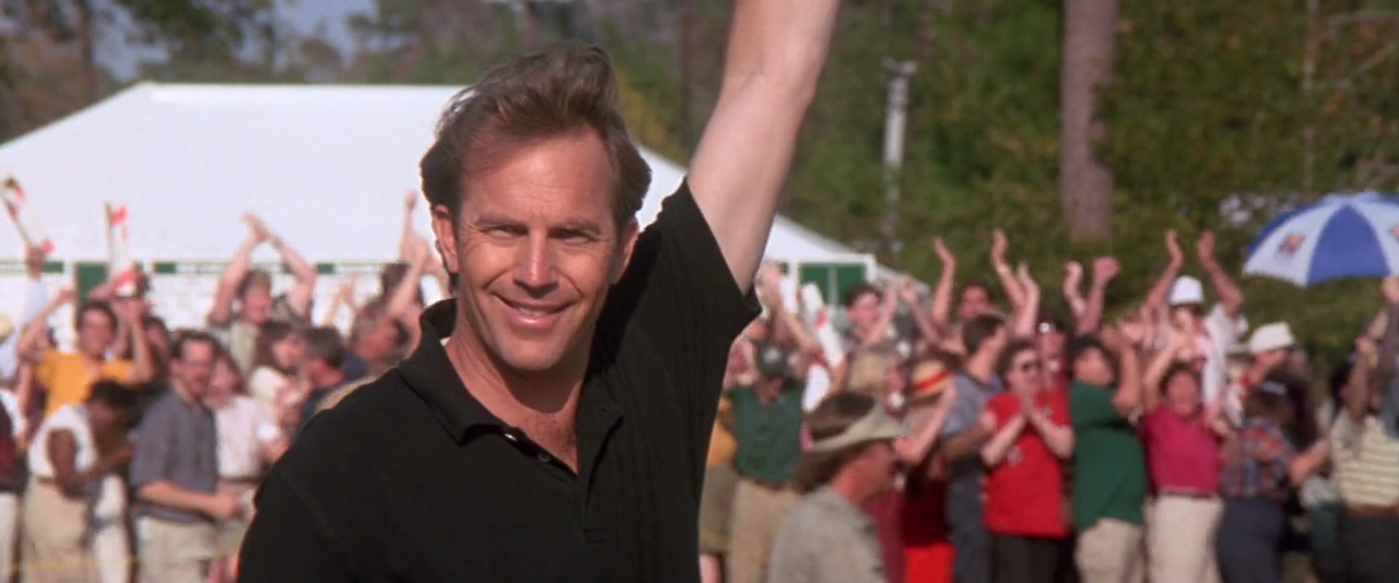 Kevin Costner wins and smiles in 'Tin Cup.' 1996.