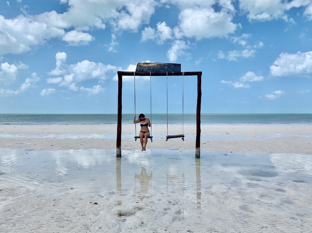 On a swing at the beach on Holbox Island, Mexico
