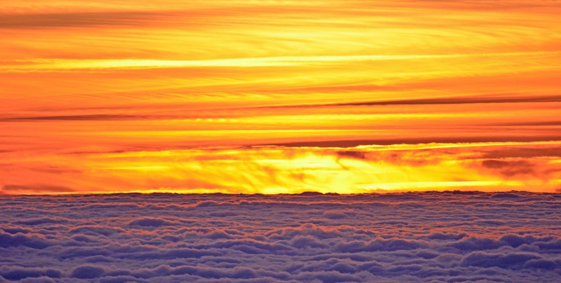 Sunset over the clouds, with many yellow-orange-red like color types.