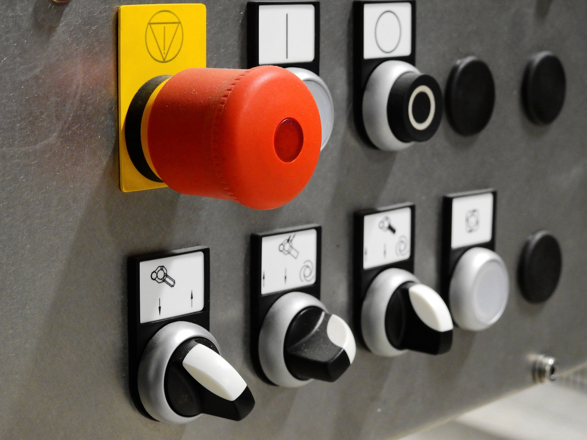 control panel with switches and a big red button