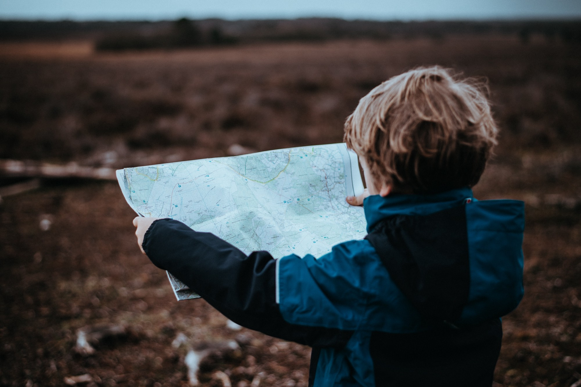 Boy looking at a map.