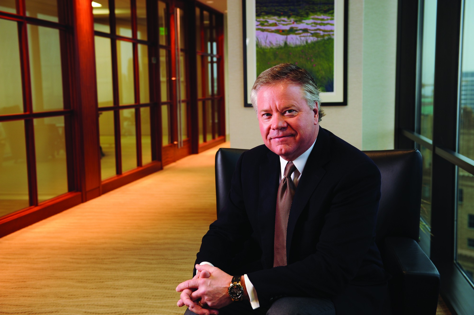 John C. Goff sits in an office wearing a suit