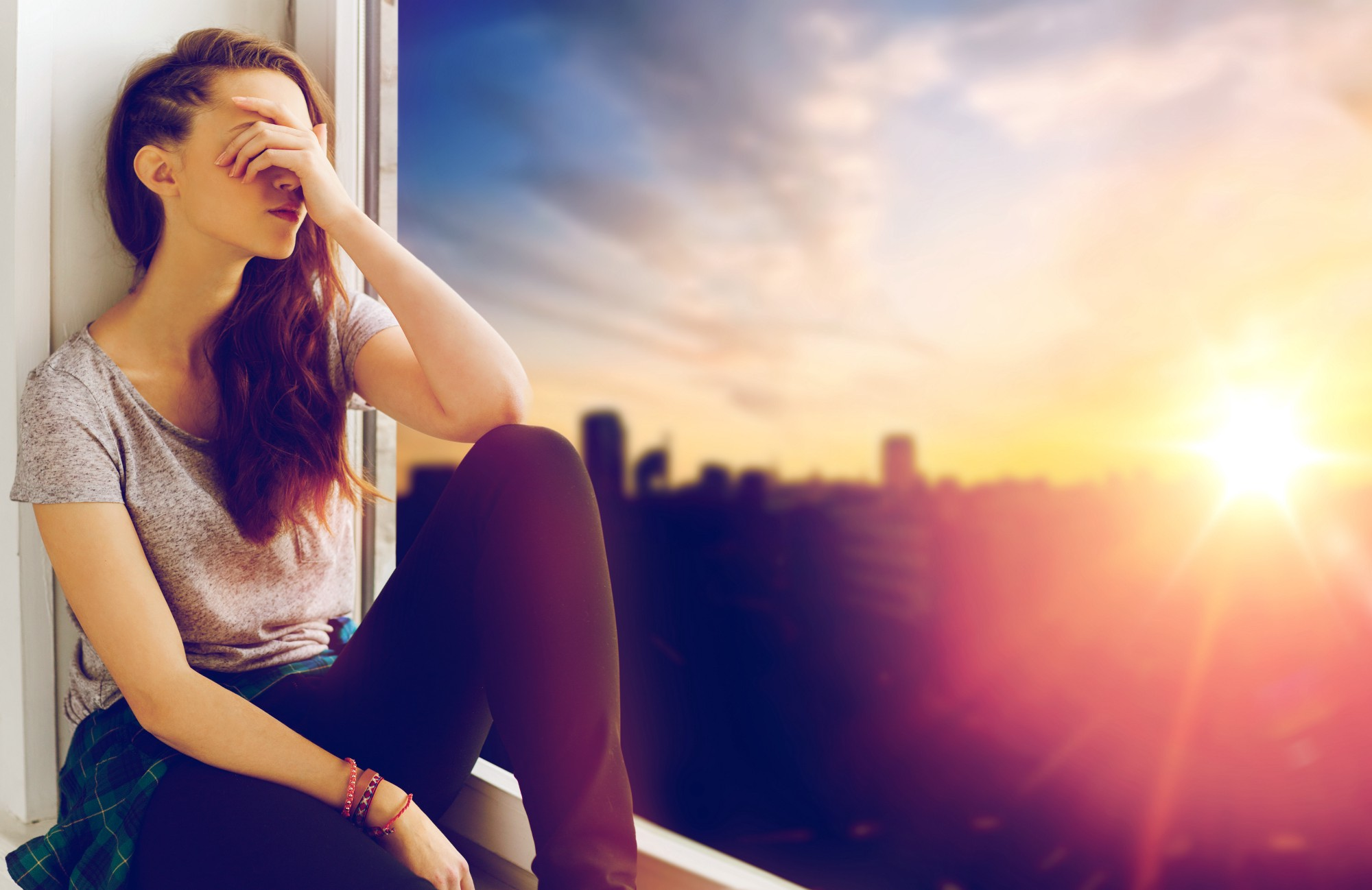 Young woman feeling shame in front of city scape