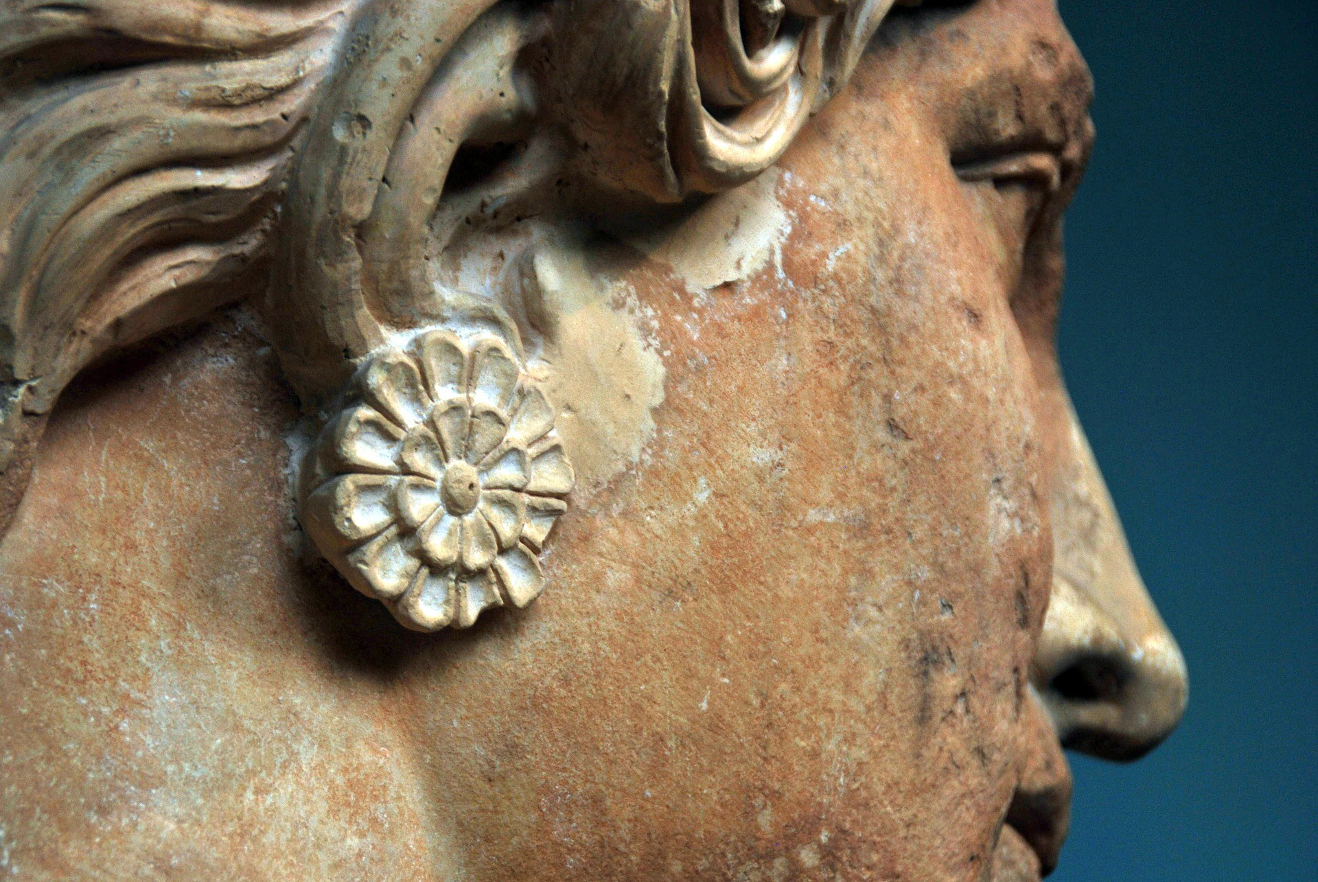 ancient Greek statue of a woman's face in profile