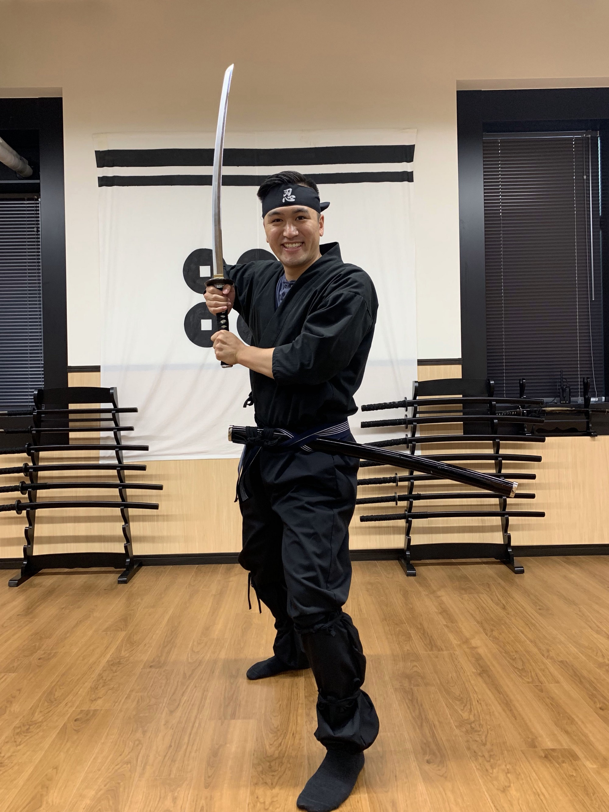 Ryan Chaw striking a pose with his katana sword.