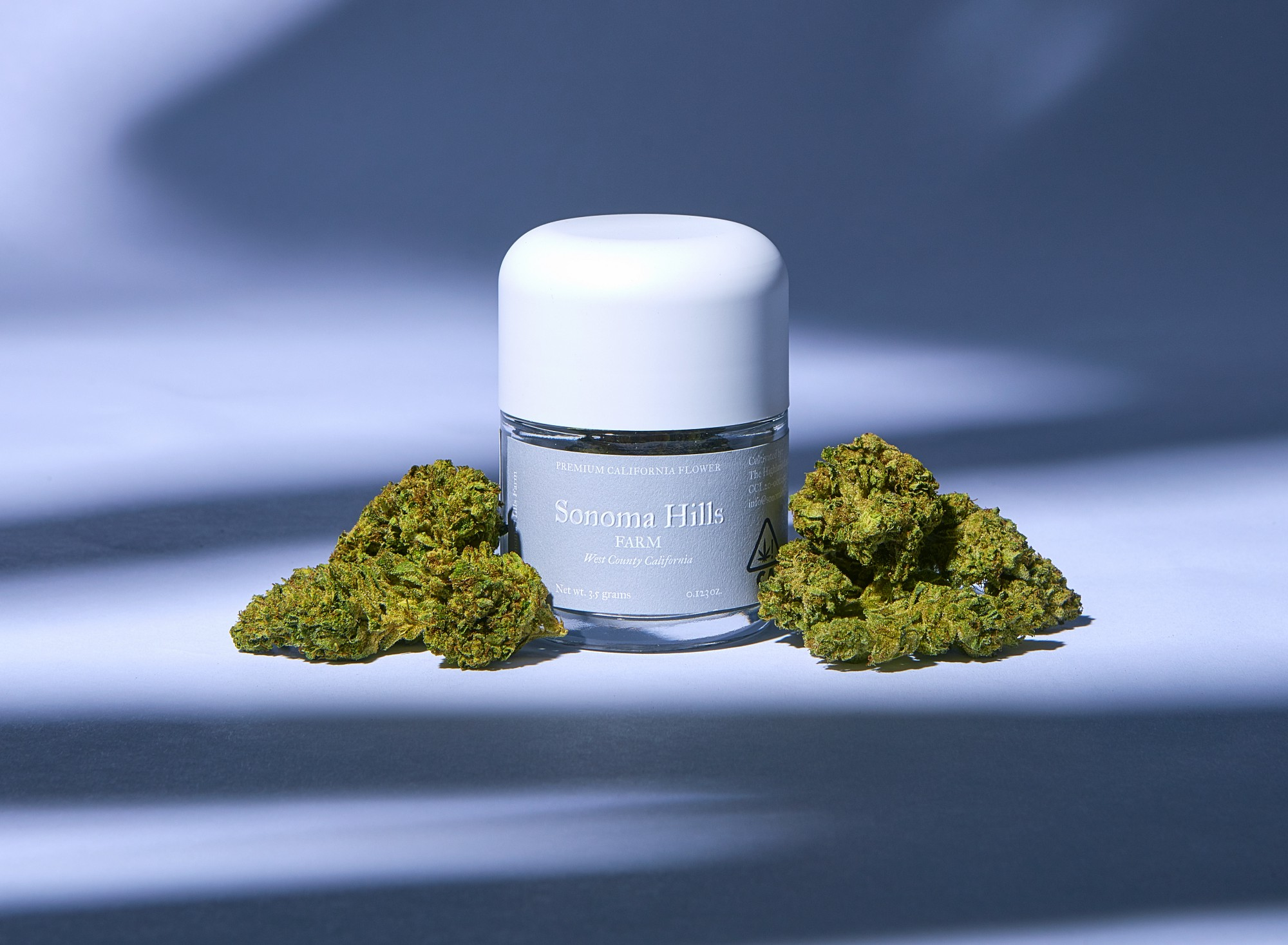 Jar with Sonoma Hills label on it with nugs of flower on either side.