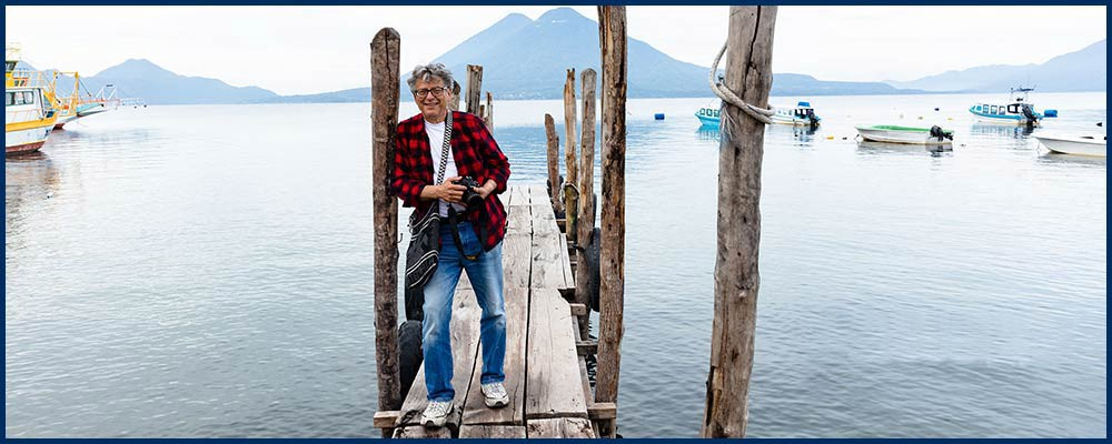 author on a pier with Lake Atitlan in Guatemala behind him