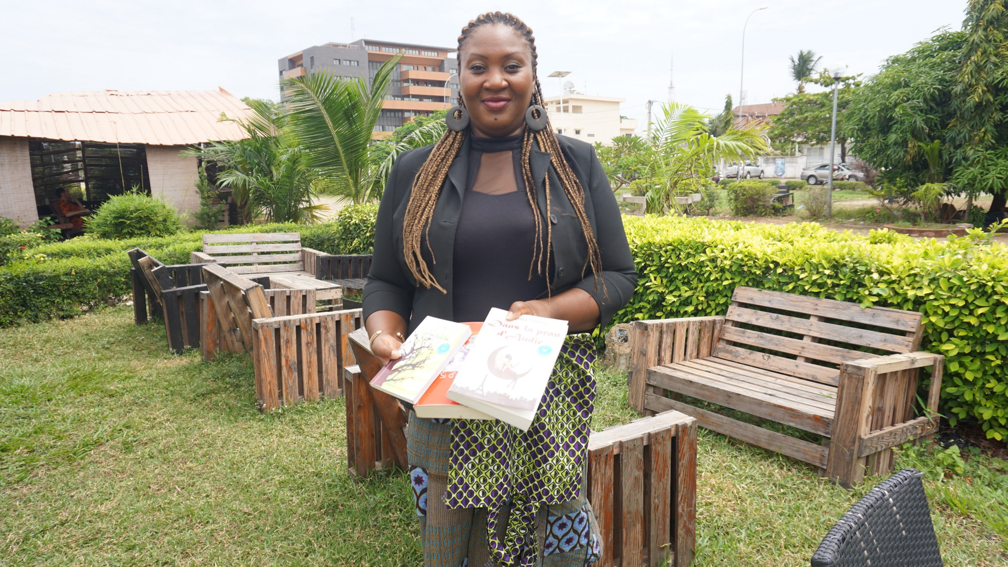 Ayaba Totin, holding some books from a typical delivery of Ayaba's Box of Books.