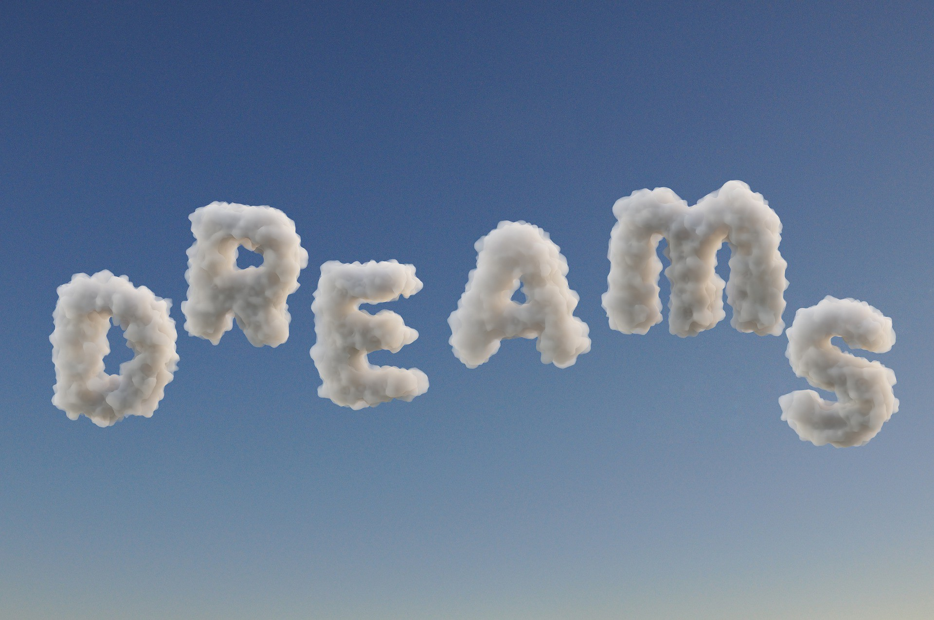 Dreams wording written on the sky background