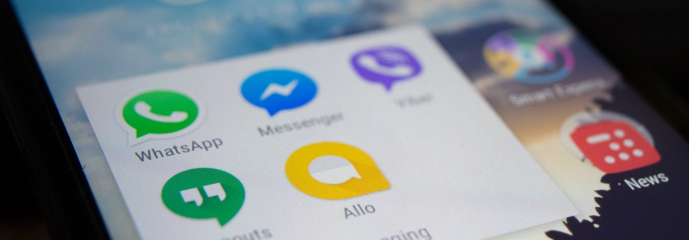 A photo of a smartphone messaging applications and the post headline