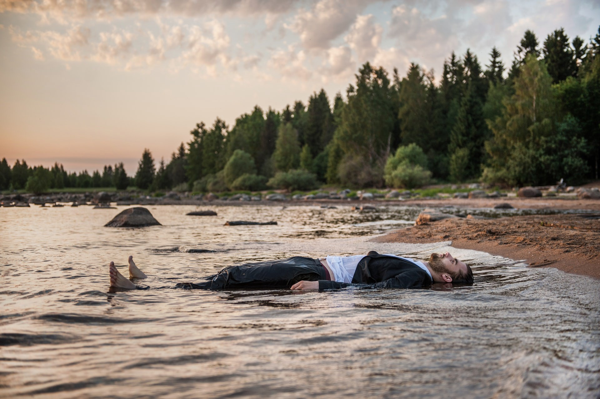 A man lying in the water.