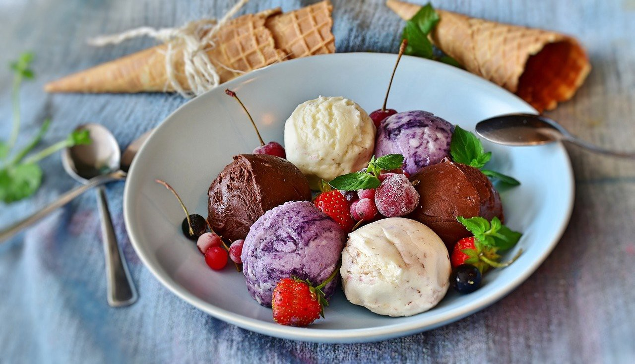 ice cream scoops with cherries and strawberries