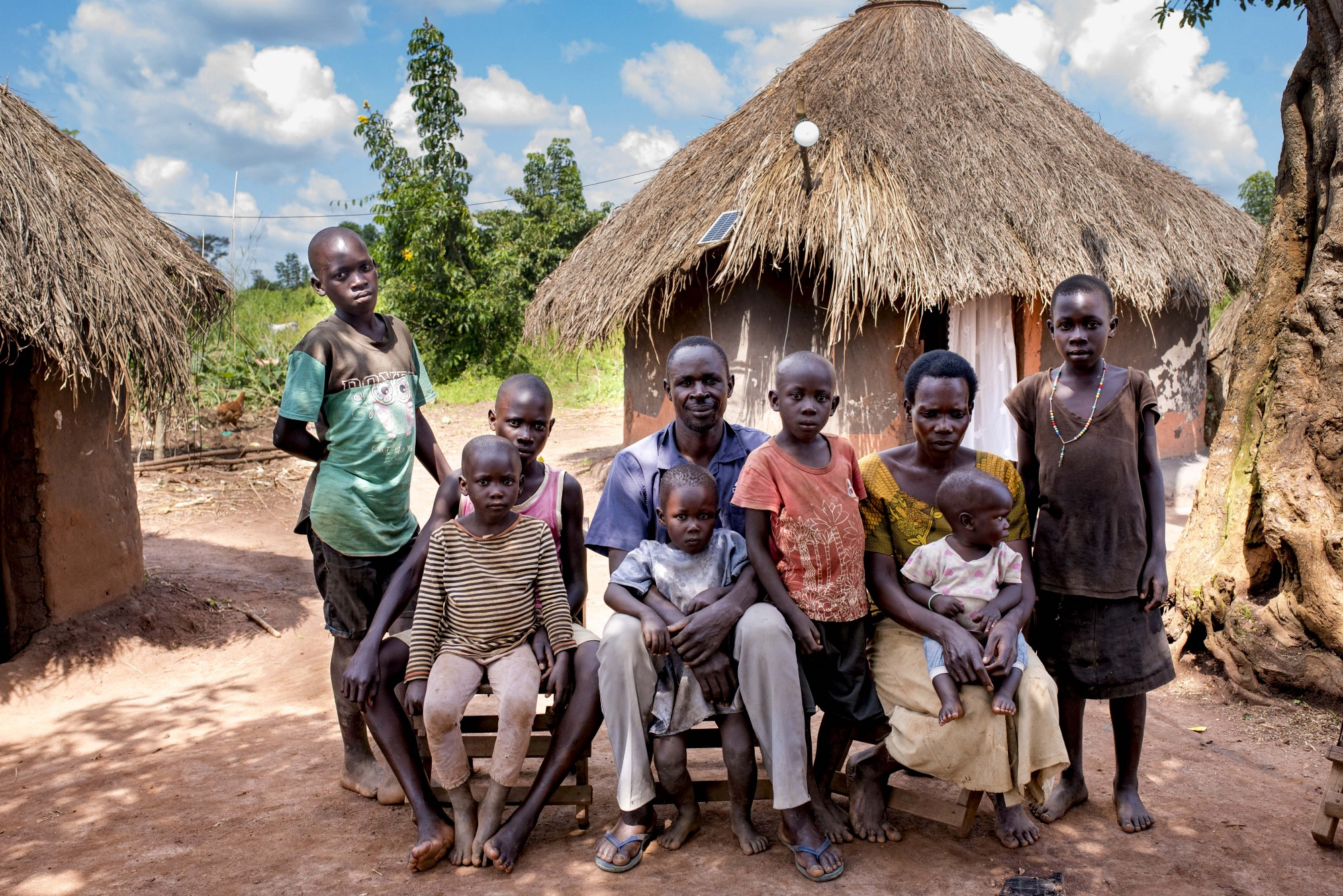 Patrick Ojok was the first BrightLife customer in Kiryandongo settlement in Uganda as a result of the USAID/Power Africa De-Risking PAYGO Solar Home System project