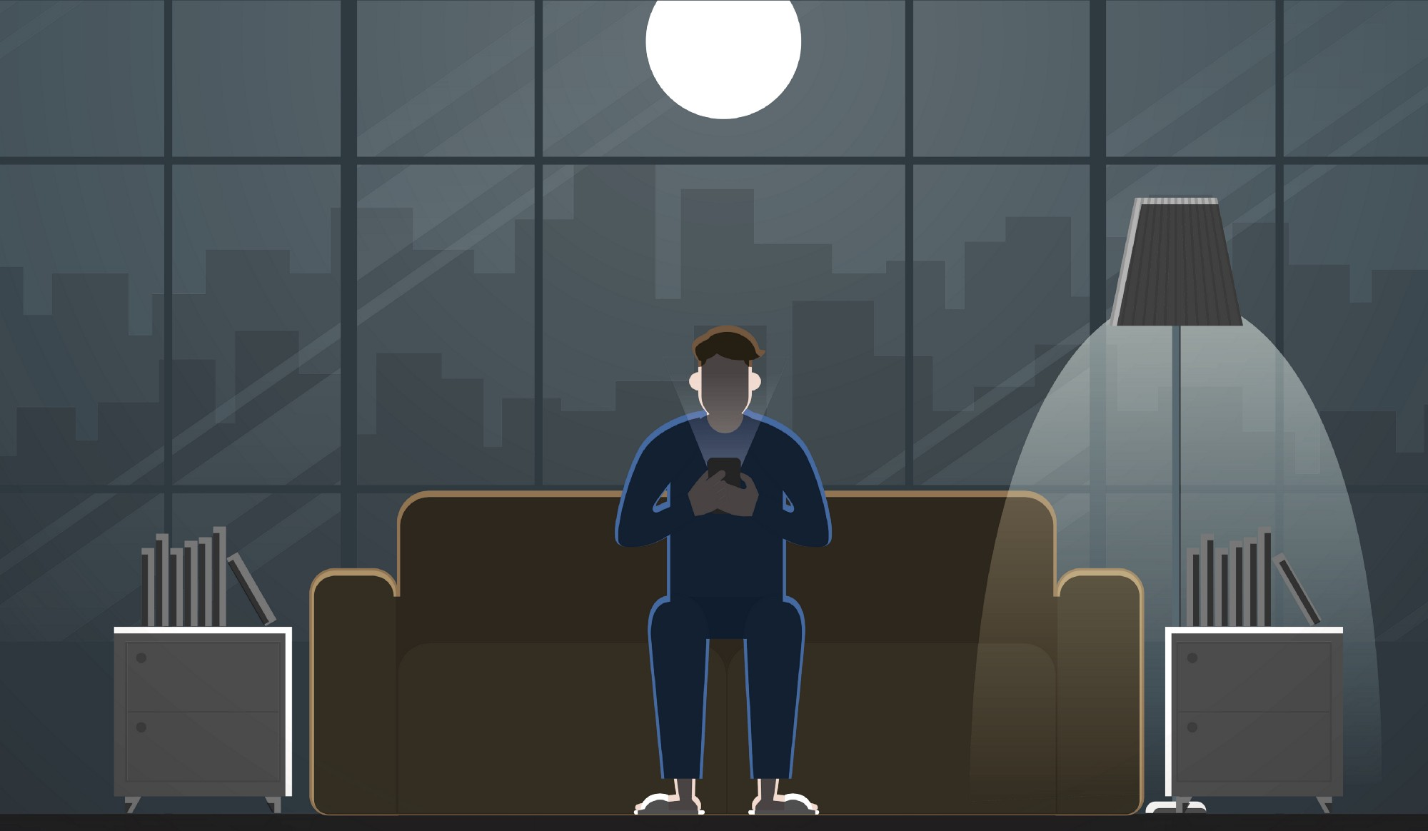 A man looks at his phone late at night.