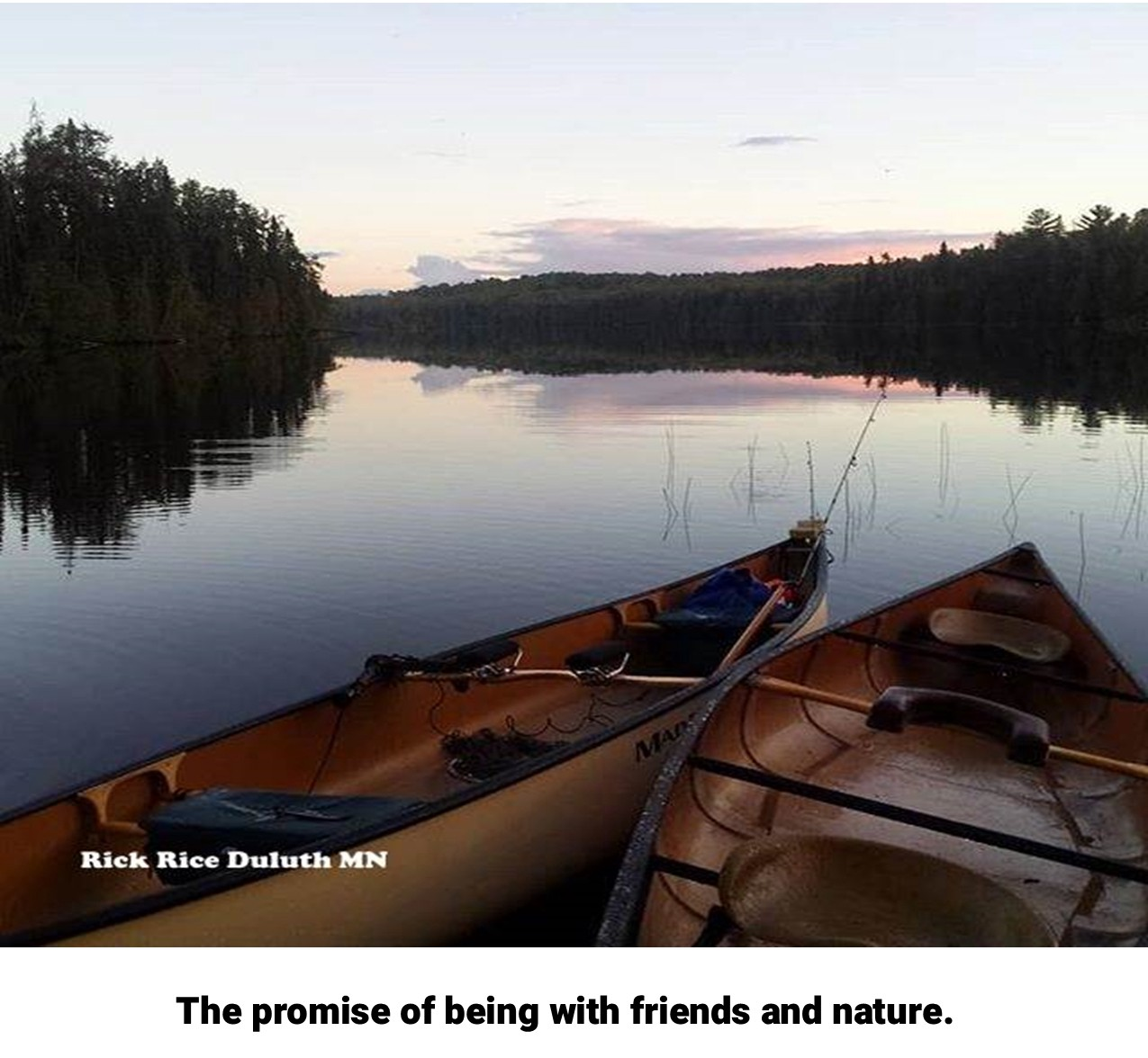 Two Canoes on a glassy water IMAGE by Rick Rice Duluth MN