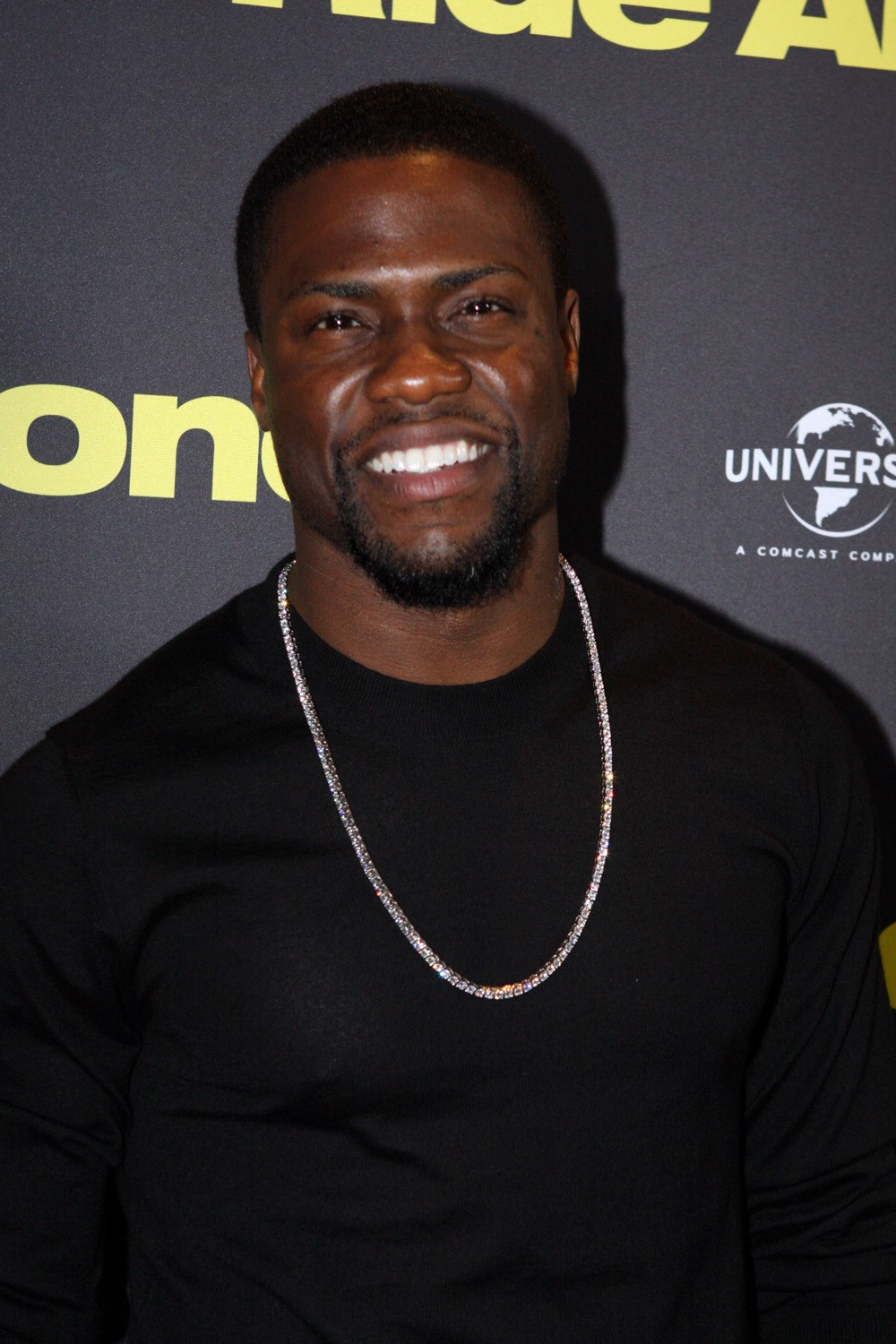 Comedian and actor Kevin Hart wearing a black shirt and a chain