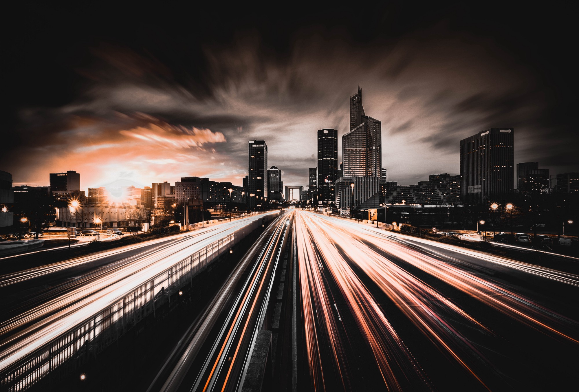 Highway with blazing fast light streaks implying quick movement