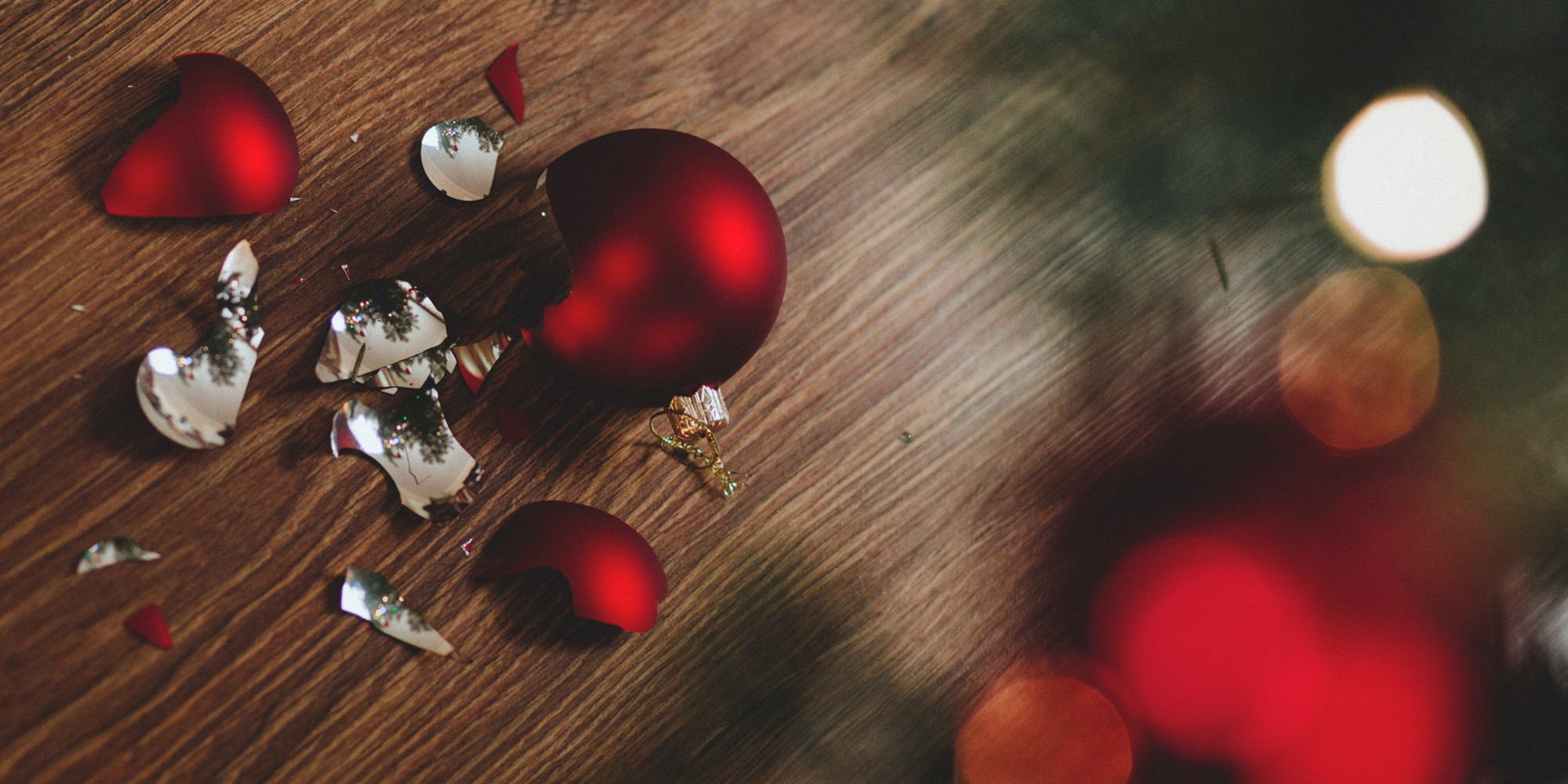 A broken bauble lies smashed by the Christmas tree
