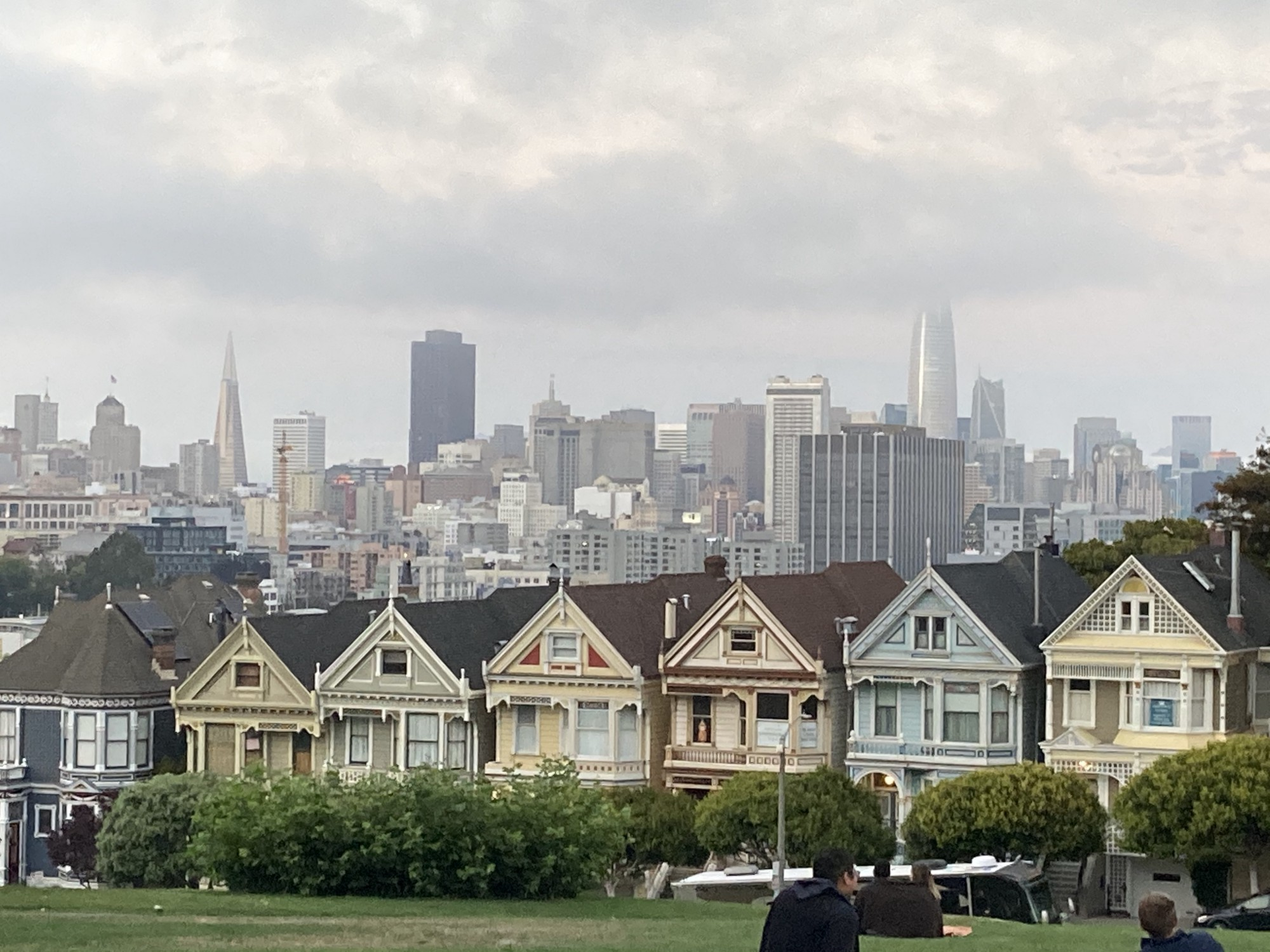 San Francisco's iconic Victorians are surrounded, as always, by the backdrop of the City under foggy skies full of foreboding.