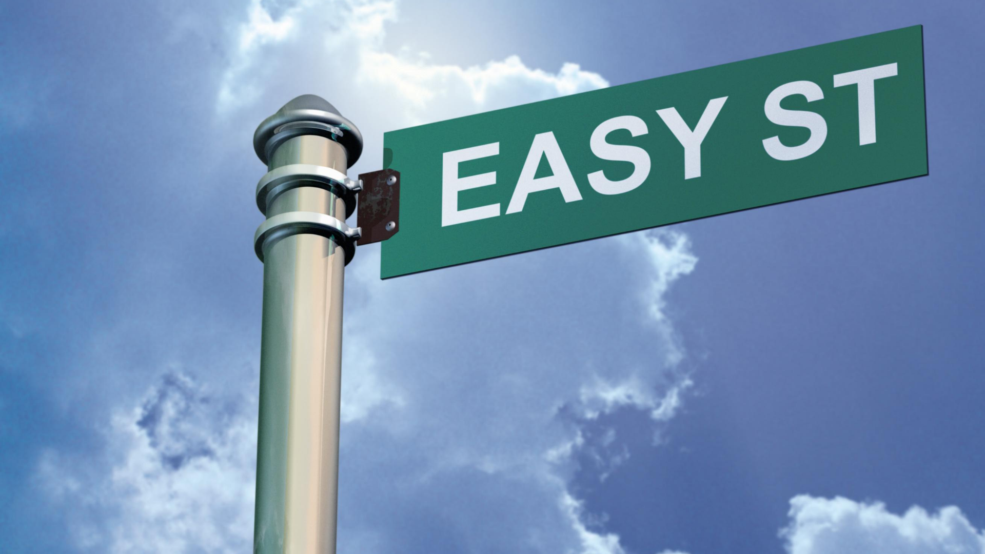 """A pole with a green street sign. White text on the sign says, """"easy street"""""""