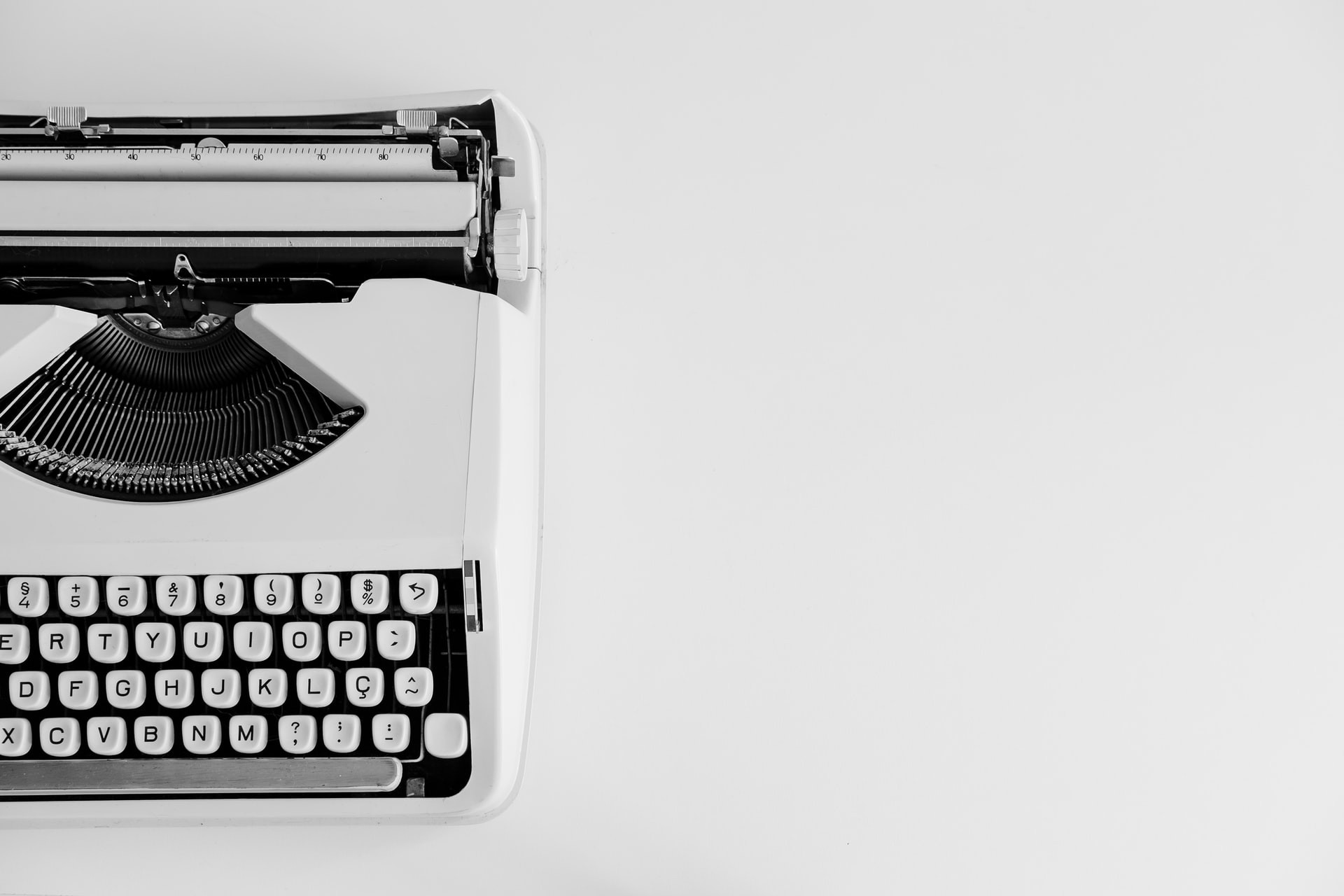 Black and white photograph of a typewriter offset to the left of the image.