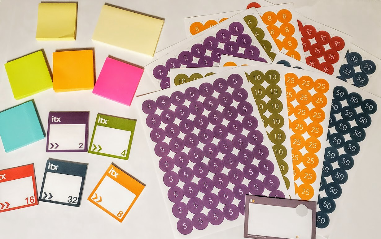 A variety of sticky notes and circle stickers with numbers in them.
