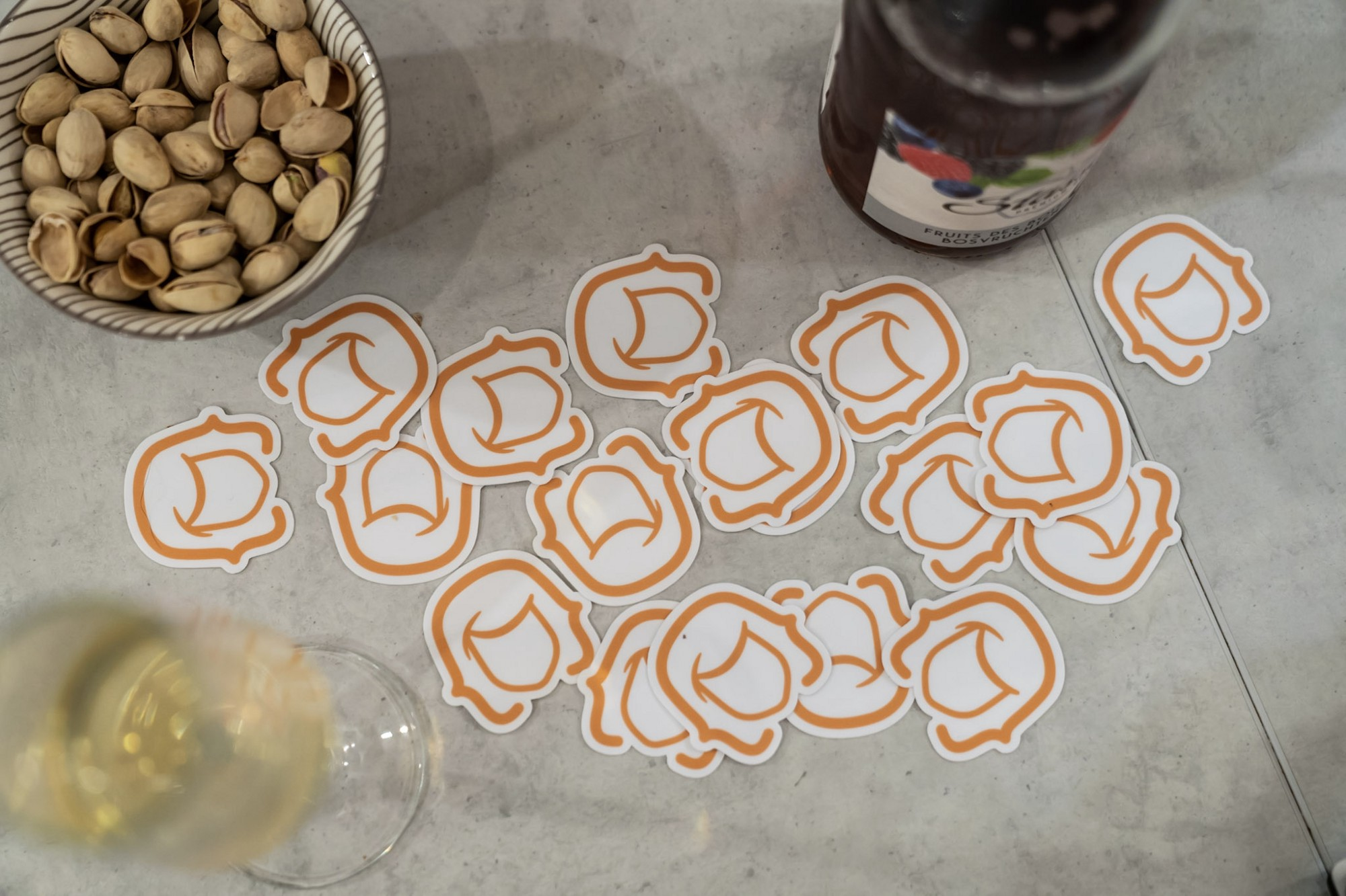 A topview of a festive table with women dot code be community stickers spread out on it