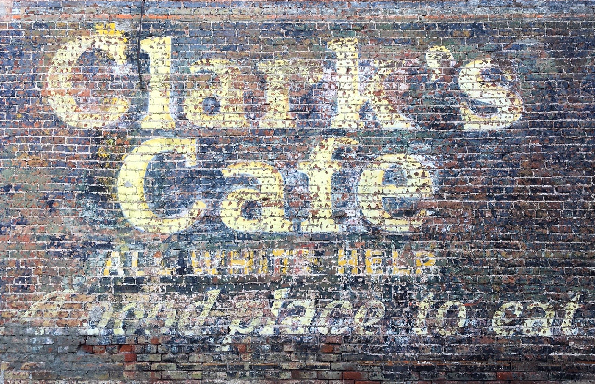 Clarke's cafe painted on brick wall, justice, culture, race