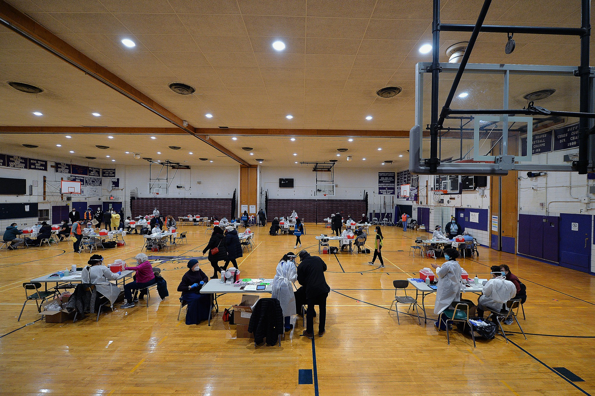 COVID-19 vaccination stations inside Hillcrest High School in Queens, NY, January 11, 2021. Photo by Anthony Behar/Reuters