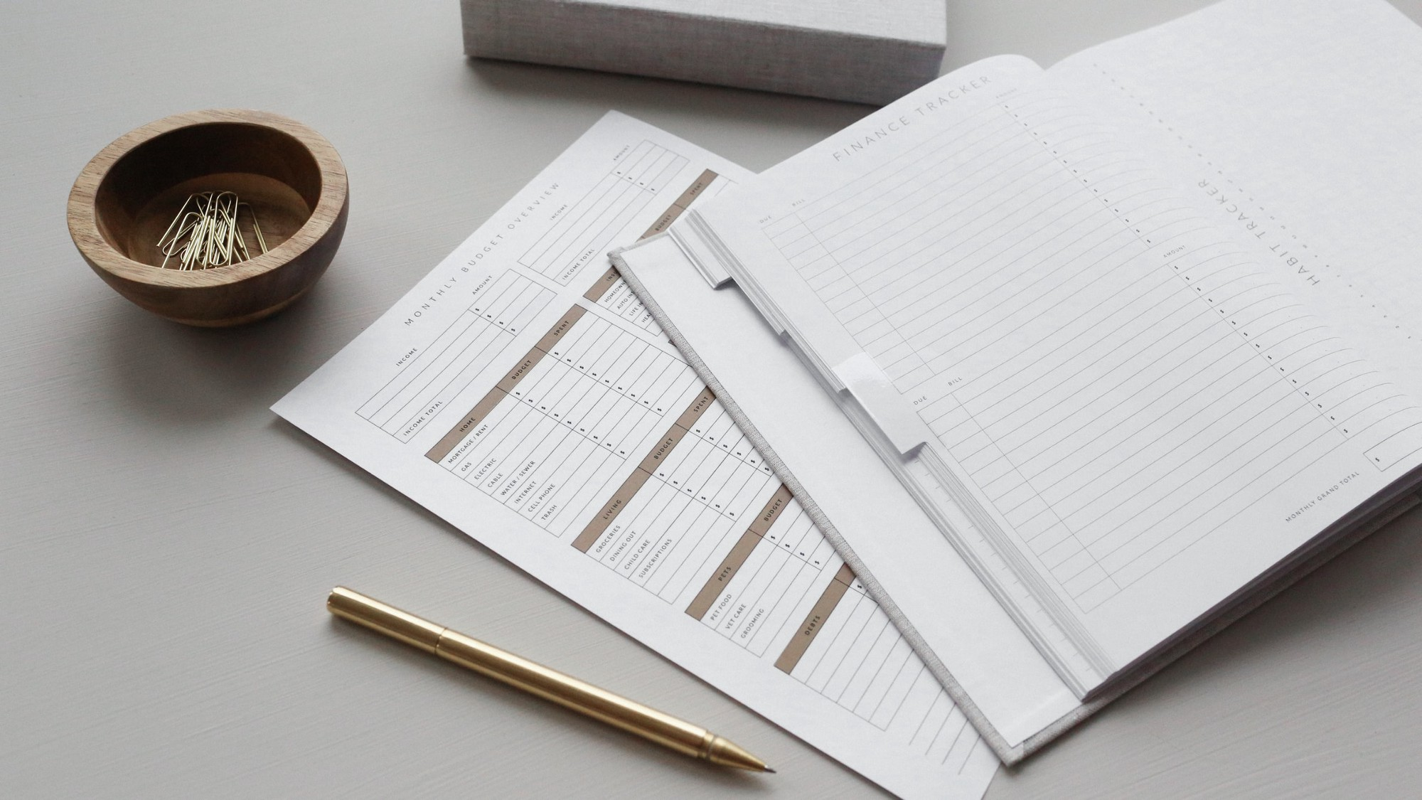 Notebook and papers on a desk.