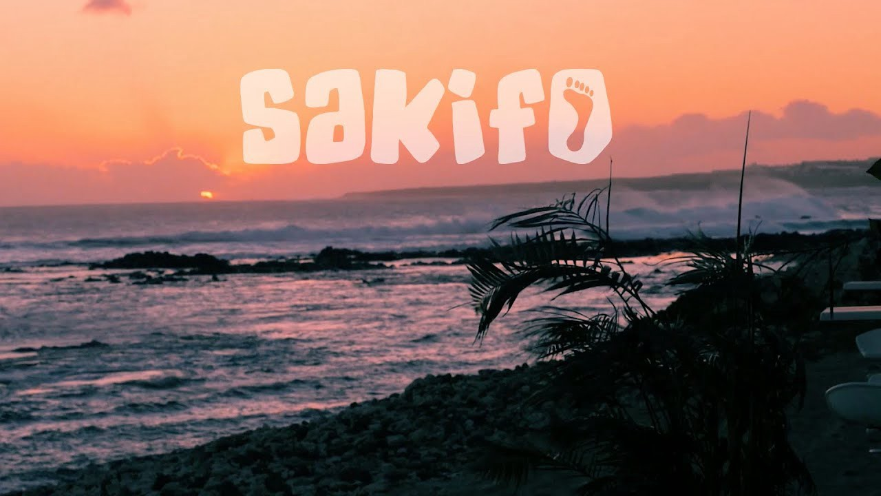 sunset on the beach and the logo of sakifo