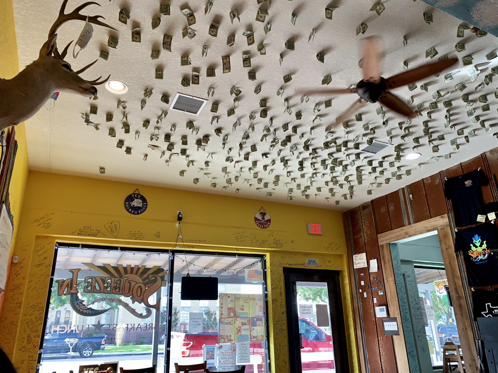 Cash taped to the ceiling of a pizza restaurant