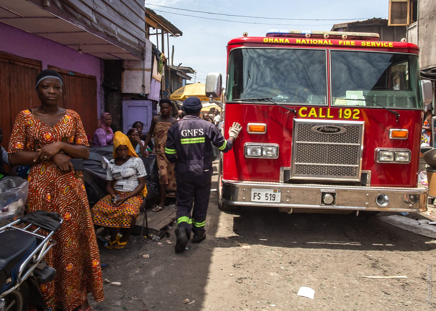 Firefighters reverse from the residence as homes burn to the ground in Agbogbloshie, Accra, Ghana. April 7, 2020. Photo by Ni