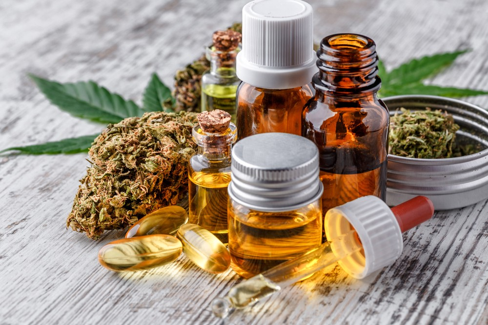 A collection of CBD oil and capsules.