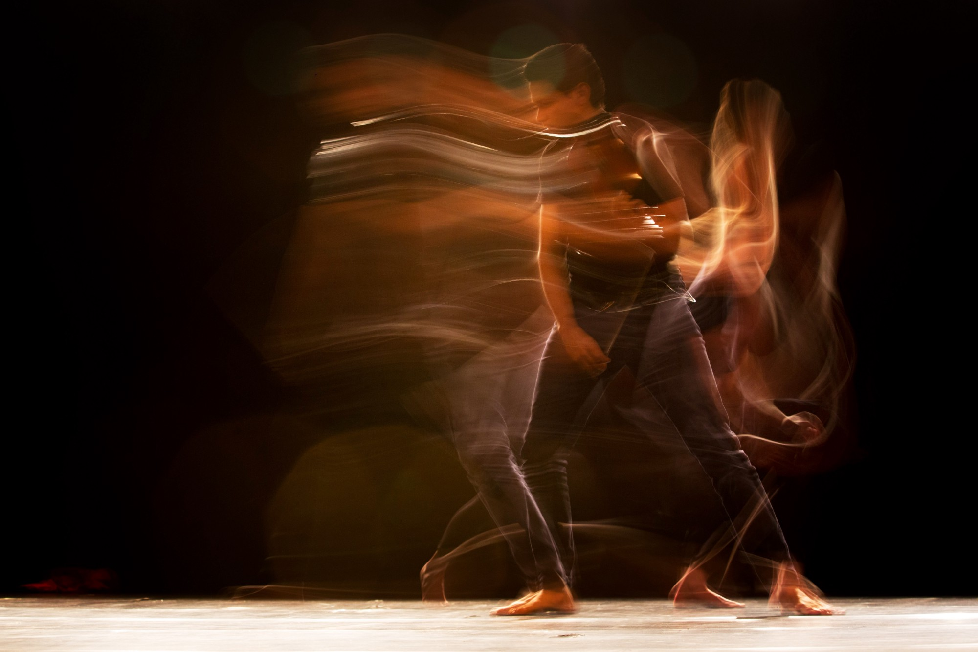 Time lapse photo of man dancing with motion blur