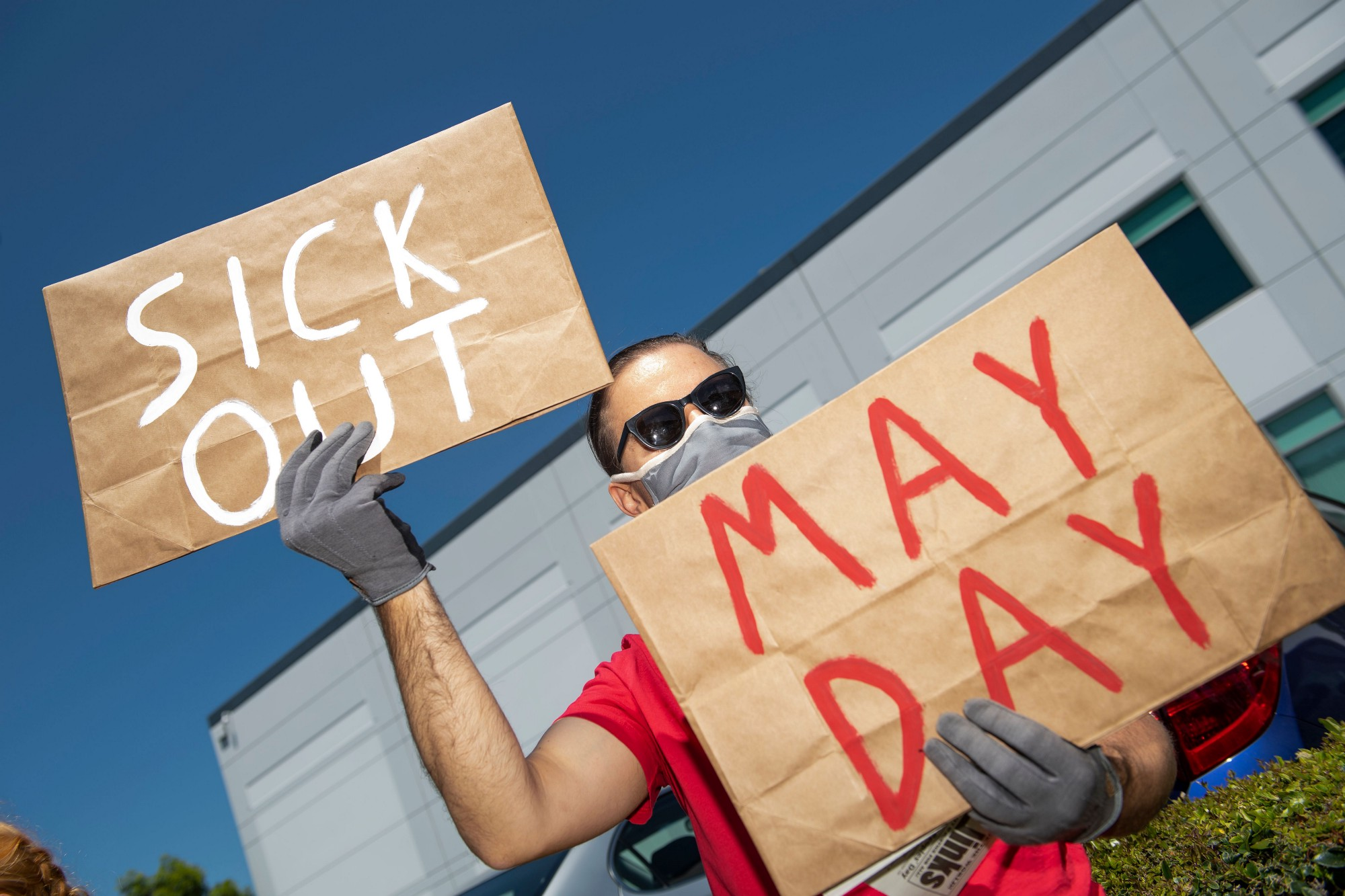 Workers protest against the failure from employers to provide adequate protections in the Amazon delivery hub workplace.