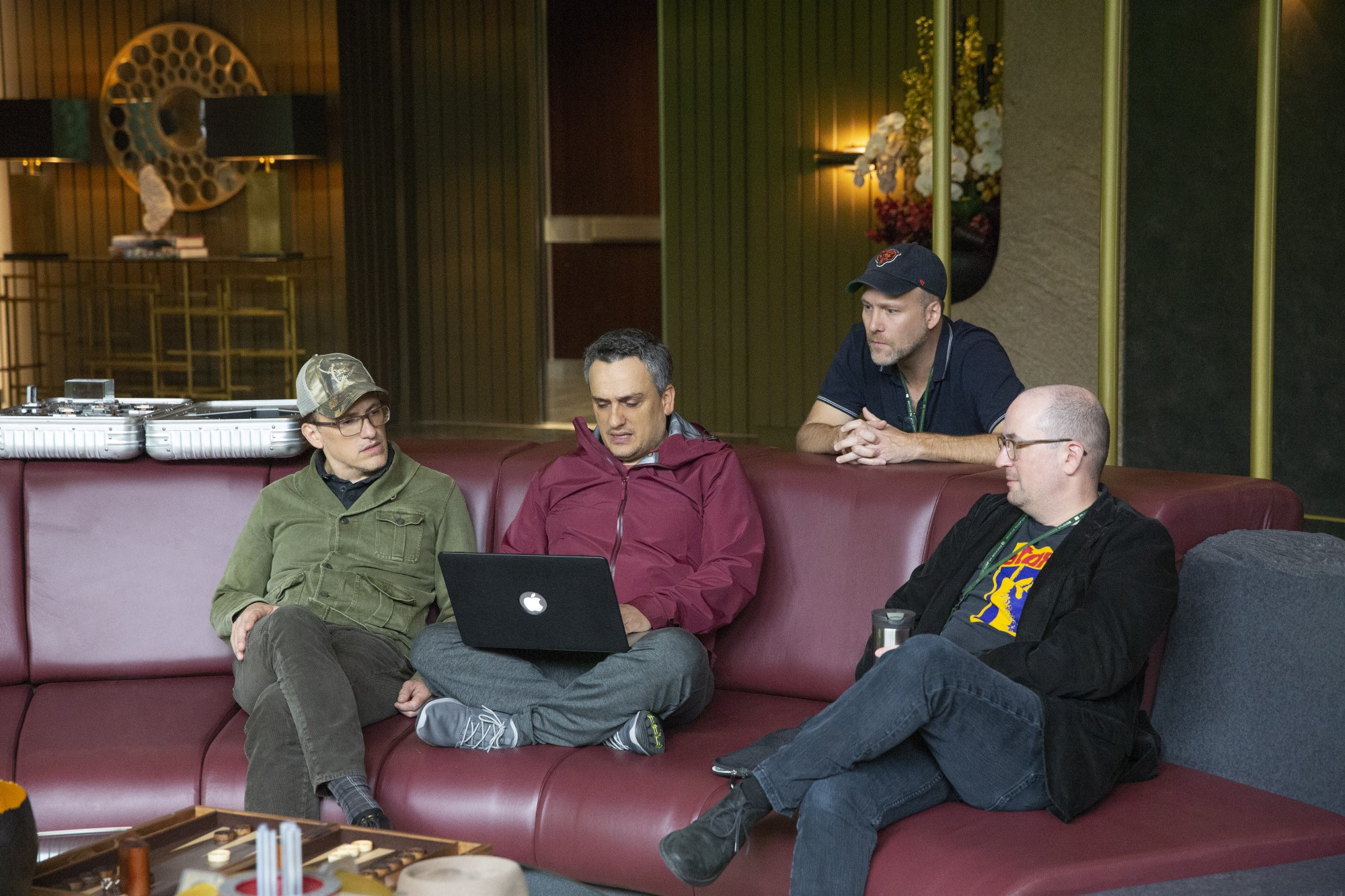 From L to R: Directors Anthony and Joe Russo consult with writers Stephen McFeely and Christopher Markus on Avengers: Endgame