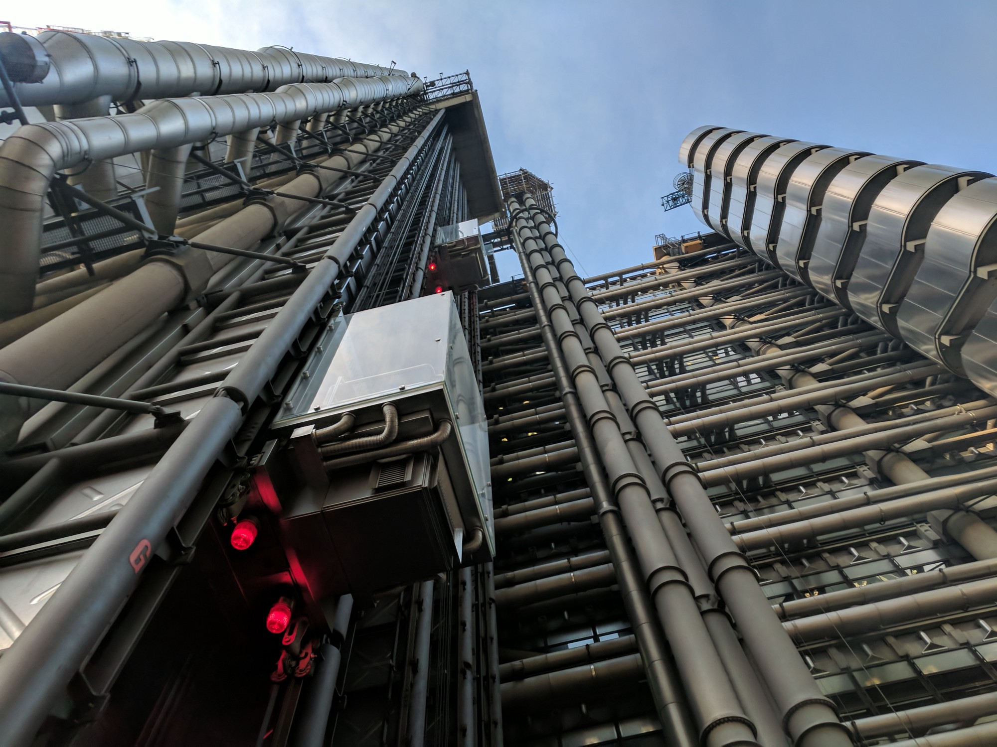Lloyds of London building. Metallic pipes covering the outside of the building